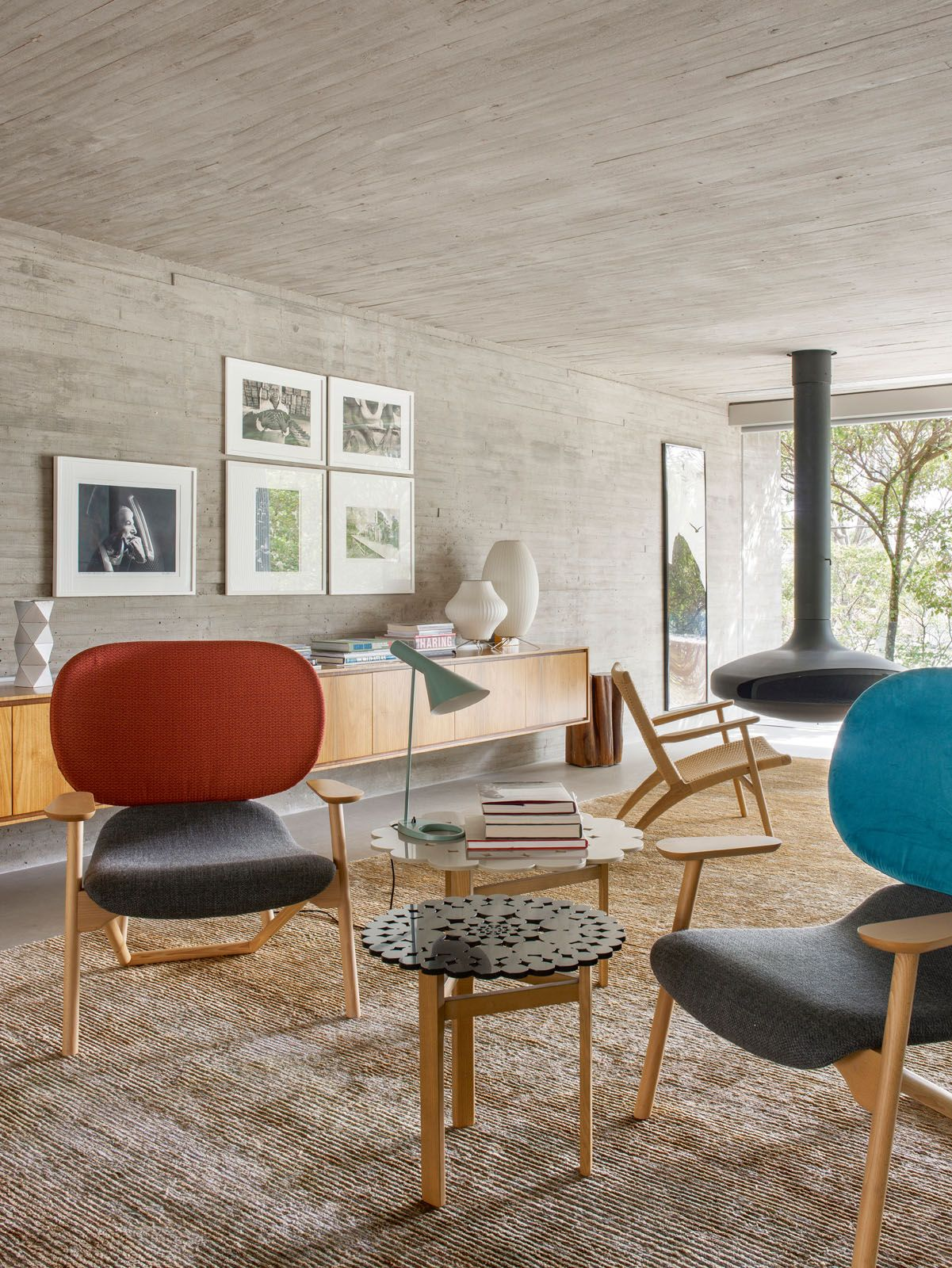 This section of the living area features a sideboard by Studio MK27, table lamps by George Nelson and a pair of Moroso Klara armchairs by Patricia Urquiola