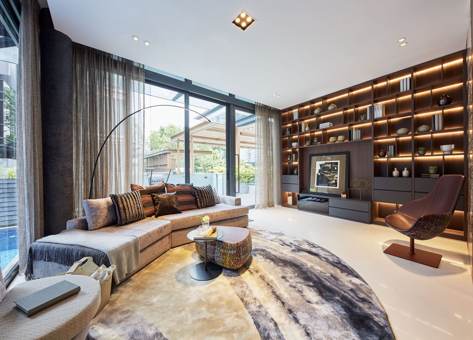 The custom-made rug anchors the living area while adding a tactile touch