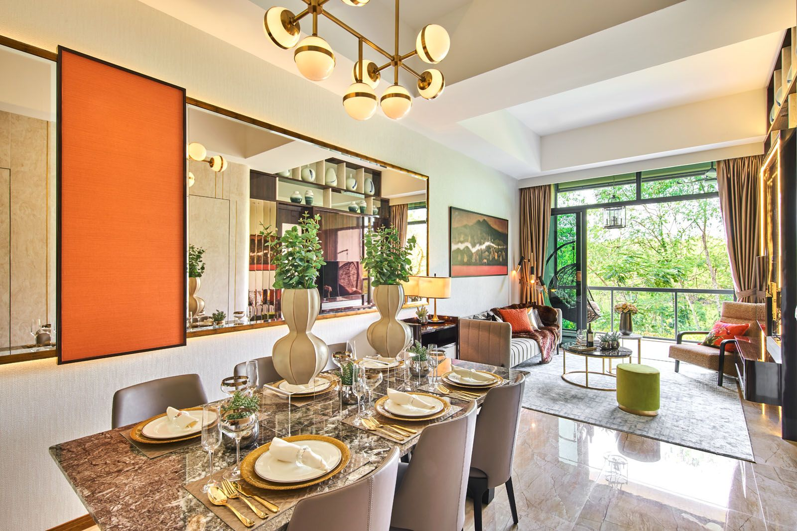 Orange wall panels and accent cushions liven up the living and dining area of this home