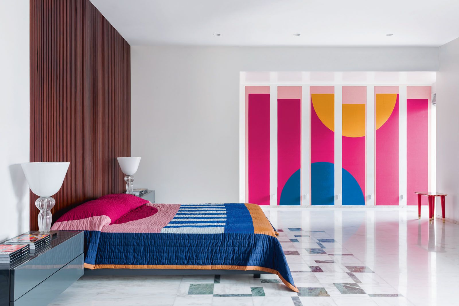 The wall mural is the focal point of this master bedroom