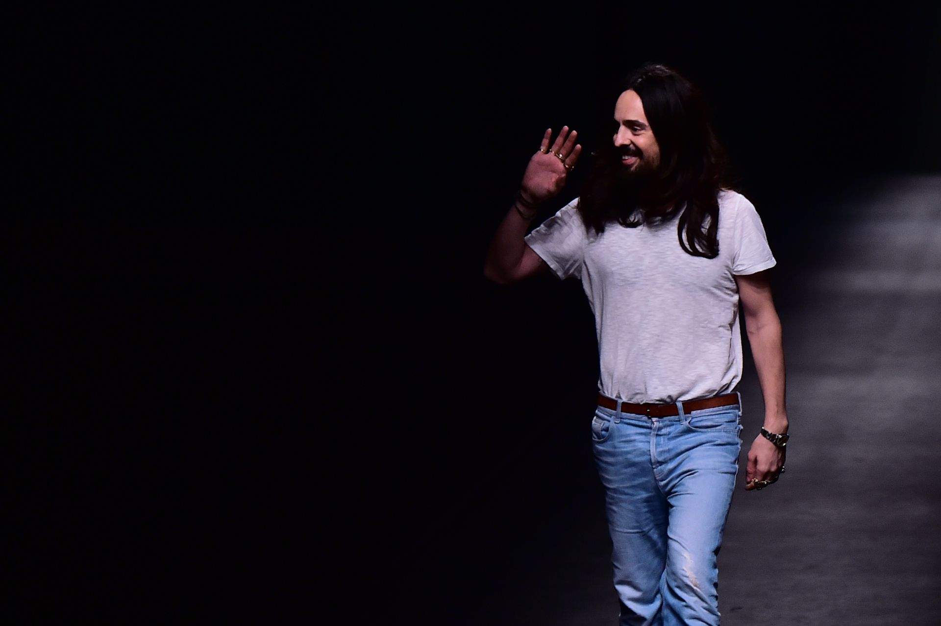Designer Alessandro Michele walks the runway at the end of the show for fashion house Gucci during the Autumn-Winter 2016 / 2017 Milan Fashion Week on February 24, 2016. / AFP / GIUSEPPE CACACE