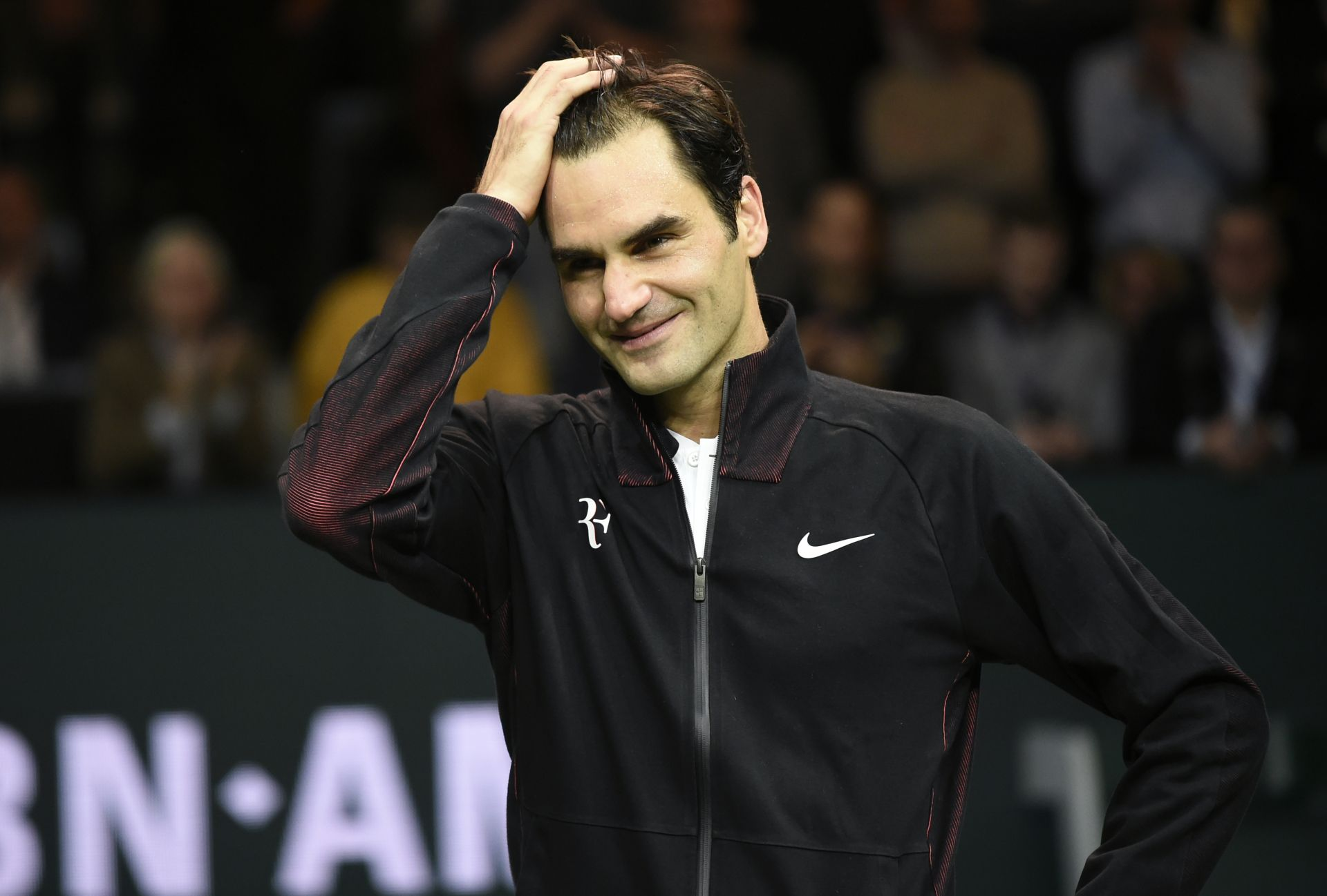 Switzerland's Roger Federer reacts as he speaks to the audience after victory over Netherlands Robin Haase in their quarter-final singles tennis match for the ABN AMRO World Tennis Tournament in Rotterdam on February 16, 2018. Roger Federer became the oldest world number one on February 16, 2018, when the 20-time Grand Slam title winner reached the semi-finals of the Rotterdam Open. The 36-year-old Swiss overcame an early setback to beat Robin Haase of the Netherlands 4-6, 6-1, 6-1 and will replace old riv