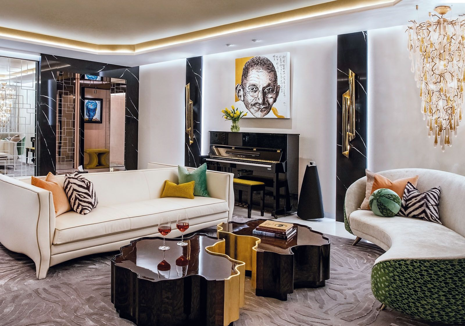 This living room features bespoke furniture by Design Intervention, a Serip chandelier, and a Mahatma Gandhi artwork