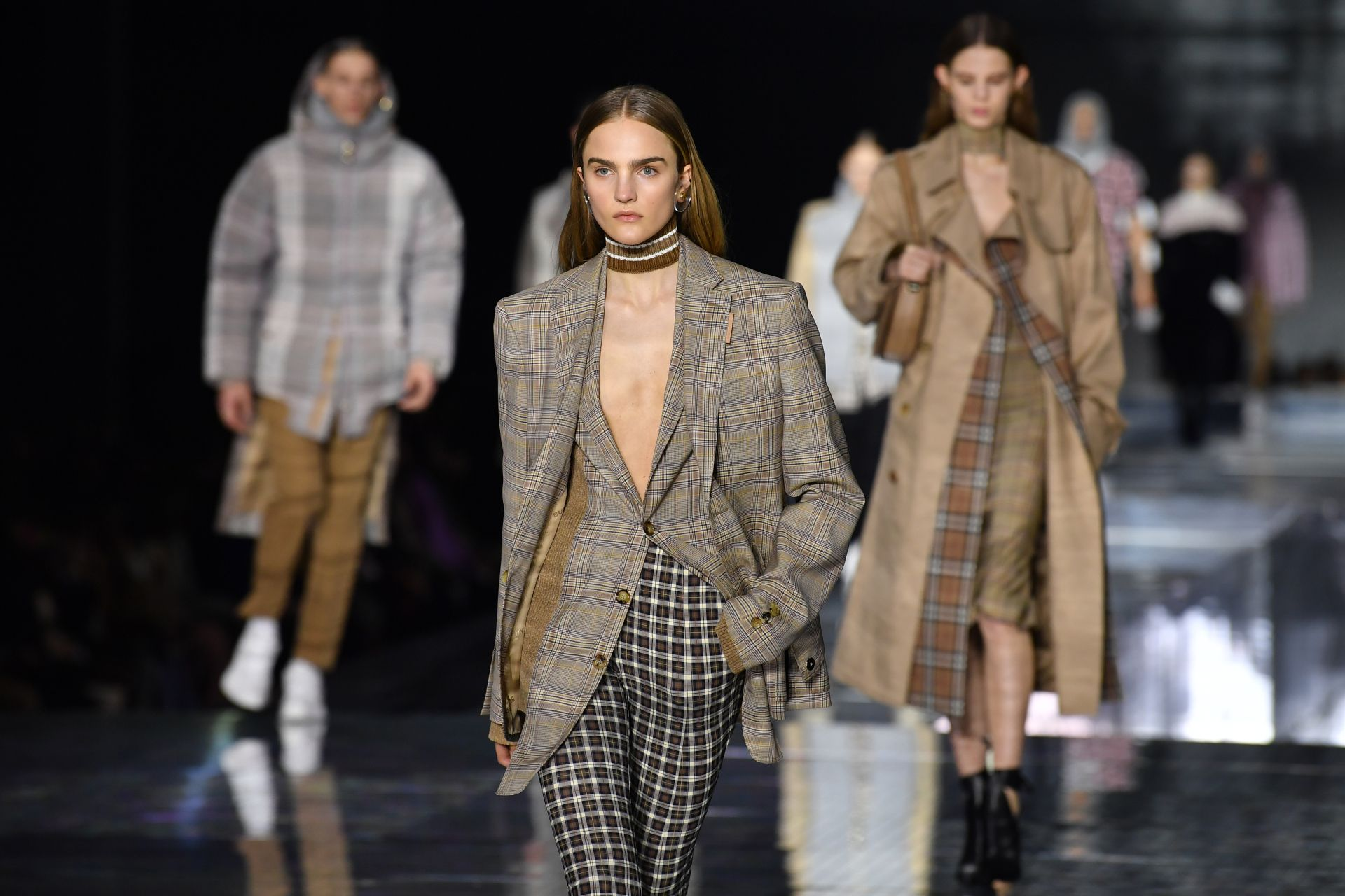 Models present creations during the British fashion house Burberry 2020 Autumn / Winter collection catwalk show during London Fashion Week in London on February 17, 2020. (Photo by Ben STANSALL / AFP)