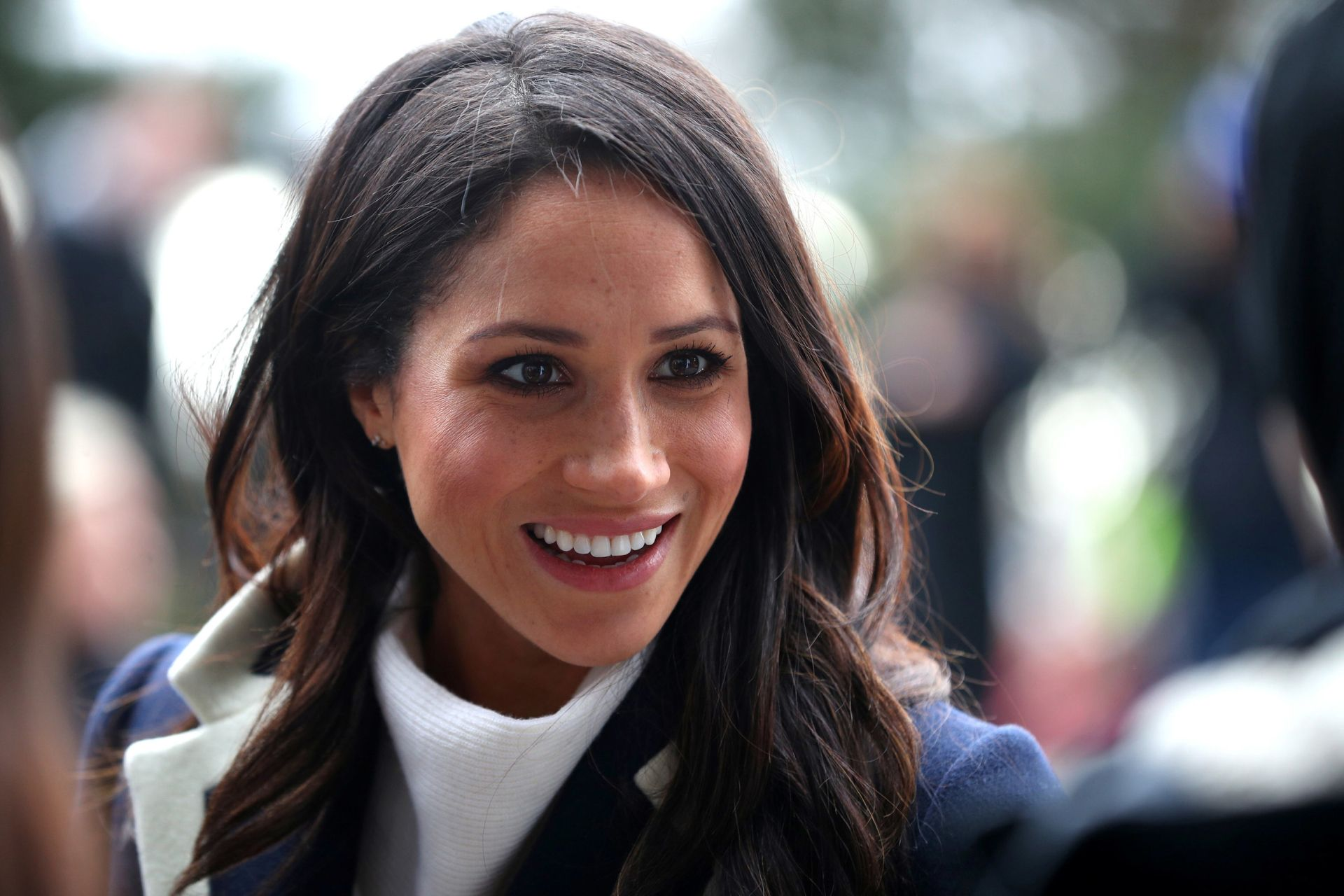 "(FILES) In this file photo taken on March 8, 2018 Britain's Prince Harry's fiancee US actress Meghan Markle greets well-wishers as she arrives with the prince at Millennium Point to attend an event hosted by social enterprise Stemettes to celebrate International Women's Day in Birmingham.Raised in Hollywood, she graduated from Northwestern University in theatre and international relations. She made her name starring as Rachel Zane in the US legal drama television series ""Suits"" from 2011 to 2017. She was a"