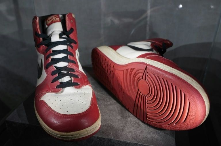 The Air Jordan 1 High, which Michael Jordan wore when he smashed the net's glass backboard during an exhibition game in Italy in 1985, are expected to sell for up to $850,000 at auction  © TIMOTHY A. CLARY - AFP