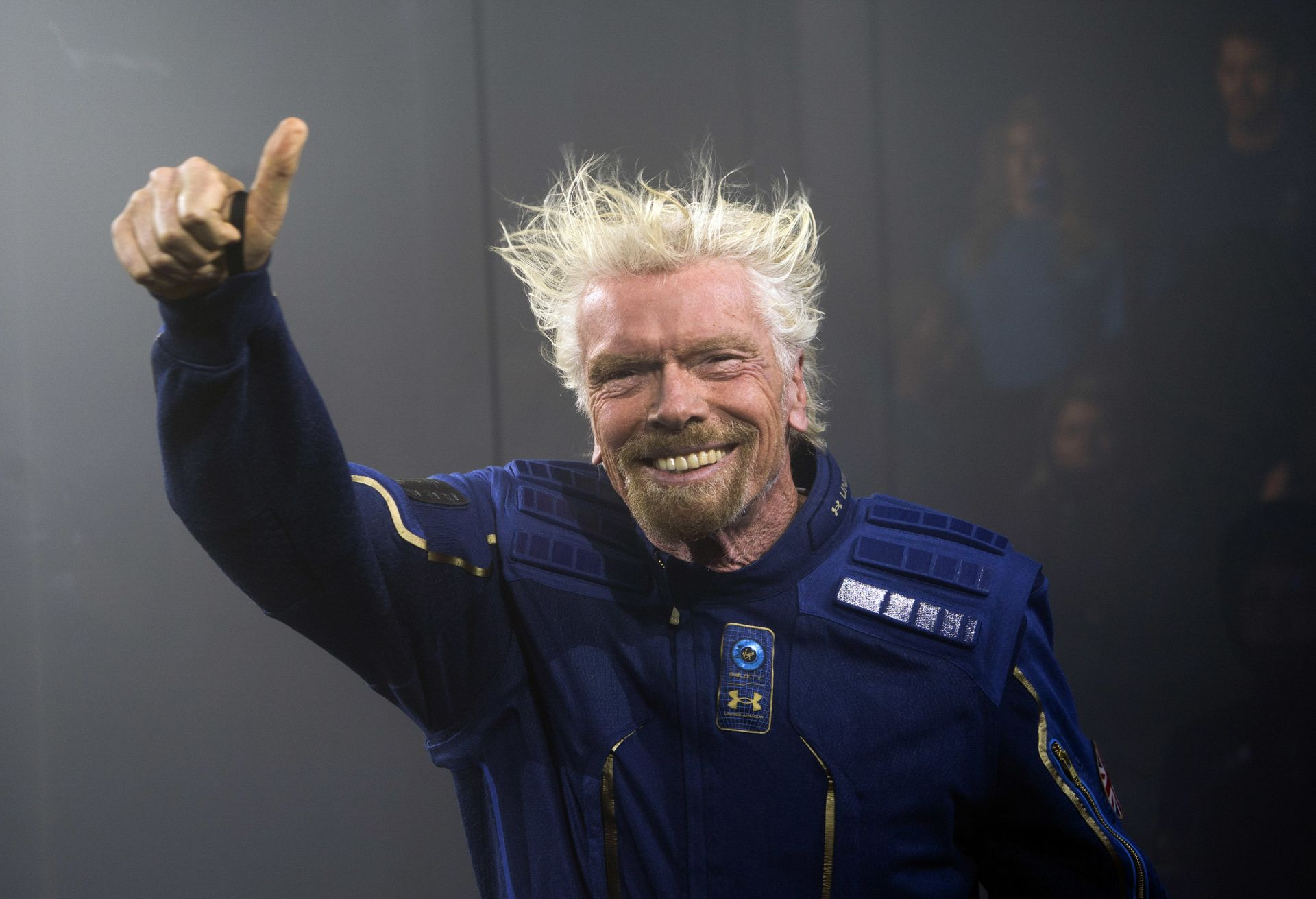 Virgin Galactic Founder Sir Richard Branson demonstrates a spacewear system, designed for Virgin Galactic astronauts, at an event October 16, 2019 in Yonkers, New York. - At the event Virgin Galactic and Under Armour unveiled the worldís first exclusive spacewear system for private astronauts. (Photo by Don Emmert / AFP)