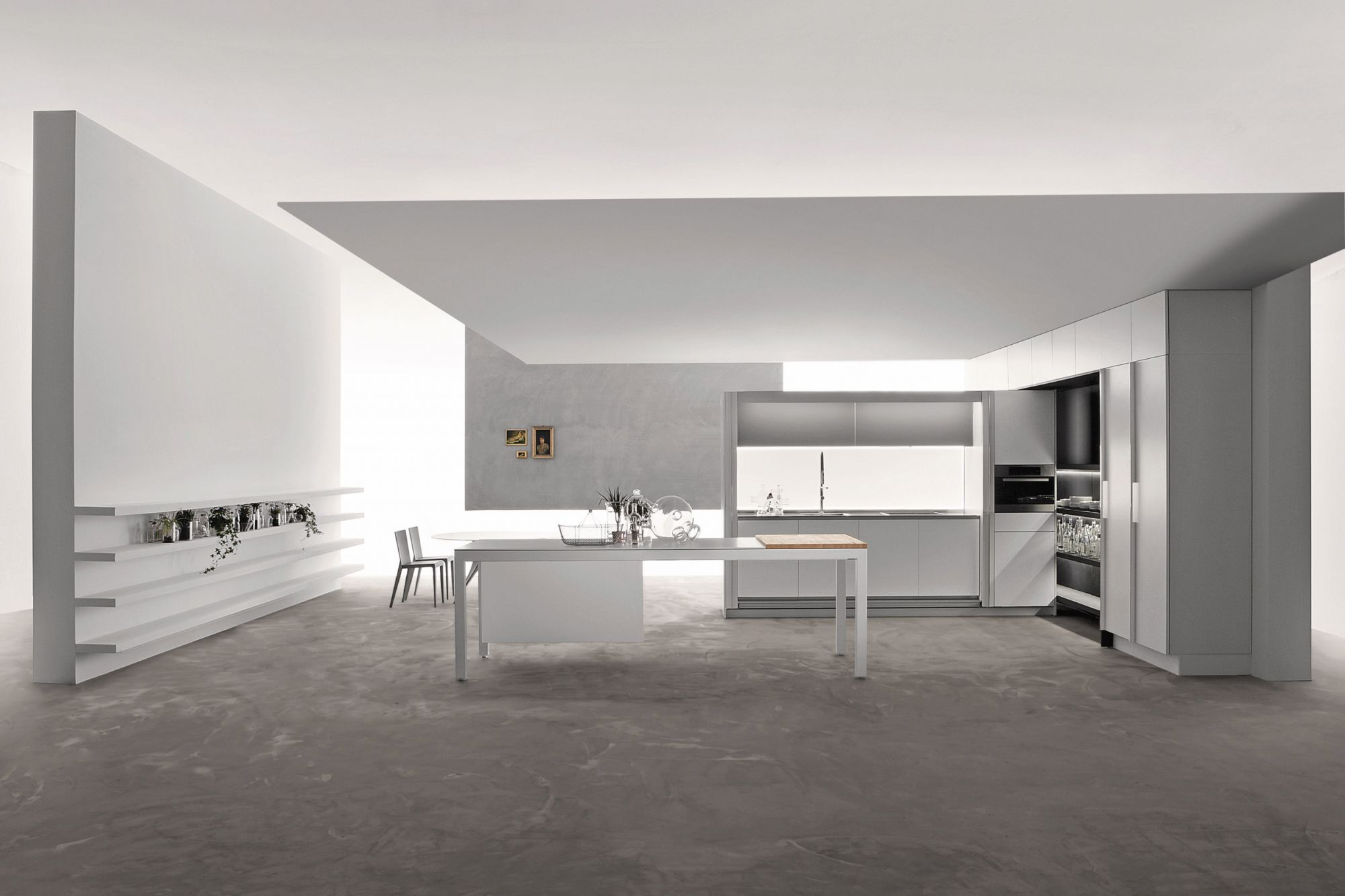The Molteni&C | Dada Tivali kitchen system from P5 incorporates sliding doors that hide your shelves and countertop when the space is not in use