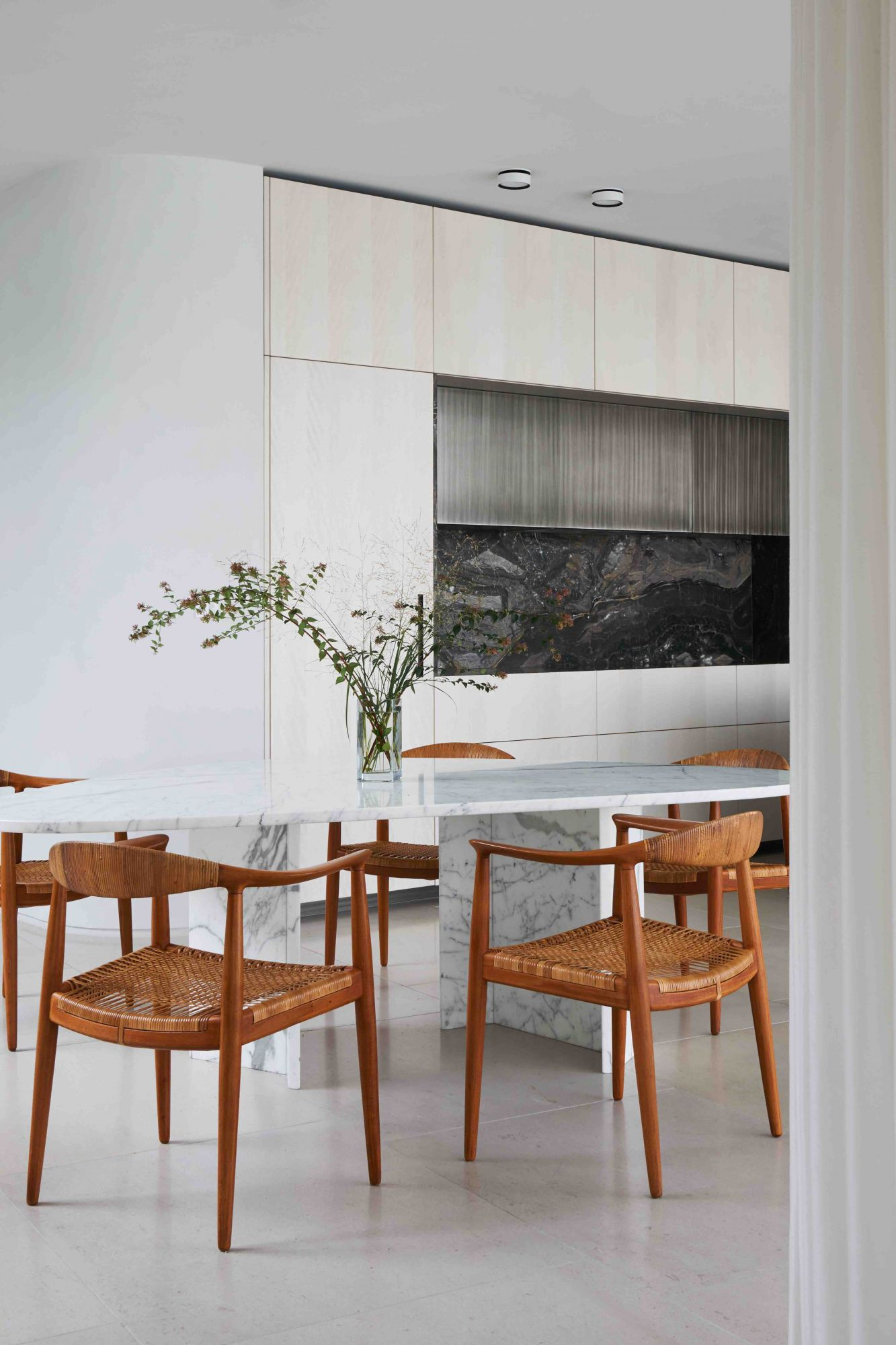 London-based architecture and design practice DH Liberty utilised black granite as an accent backsplash to deliver impact in a minimalist kitchen.