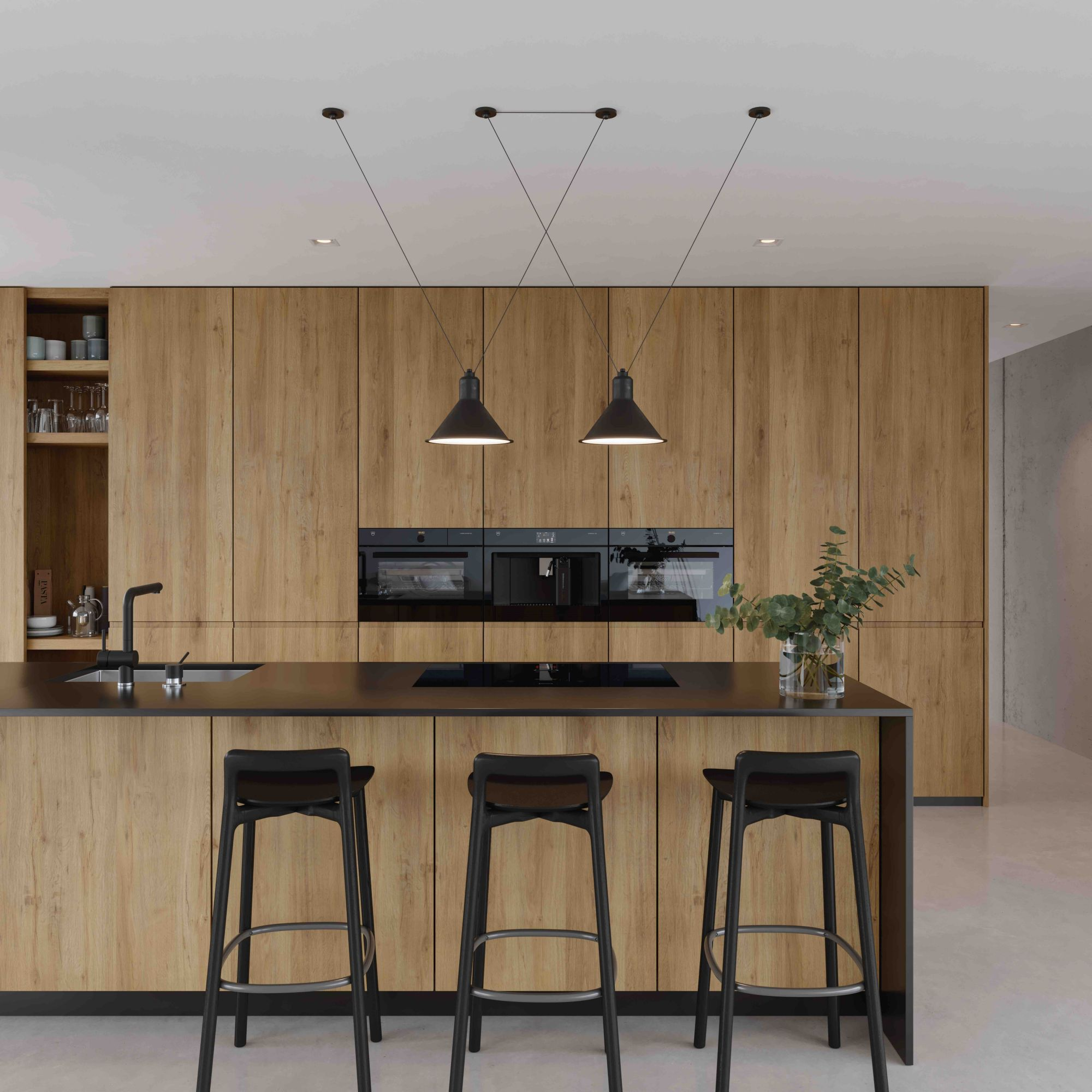 V-Zug ovens and induction cooktop pictured with light wood cabinetry