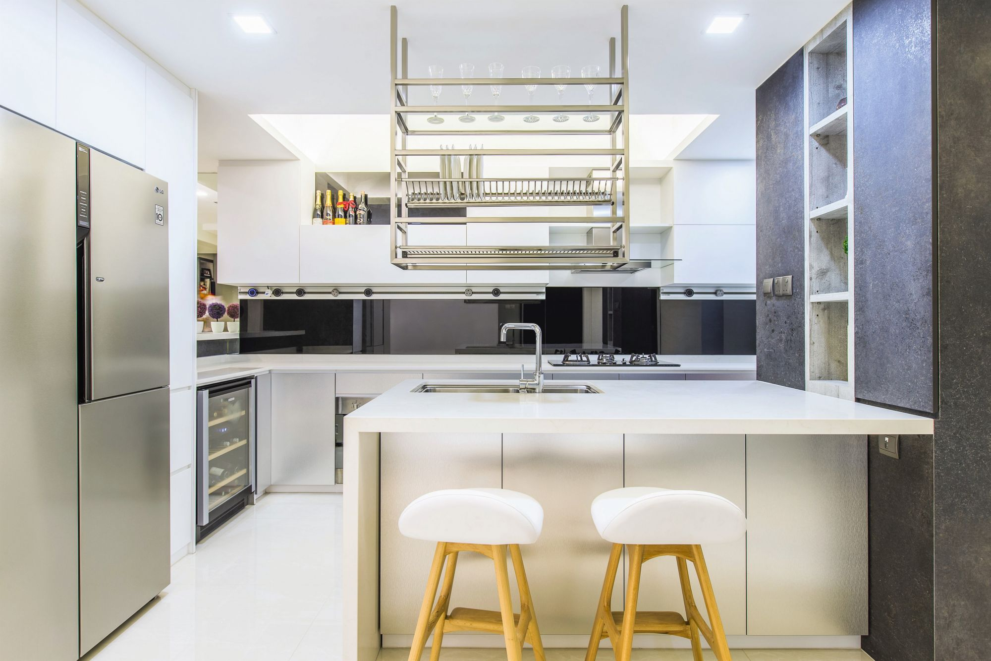 A project by Summerhaus D'zign, this minimalist kitchen features features a variety of open shelves