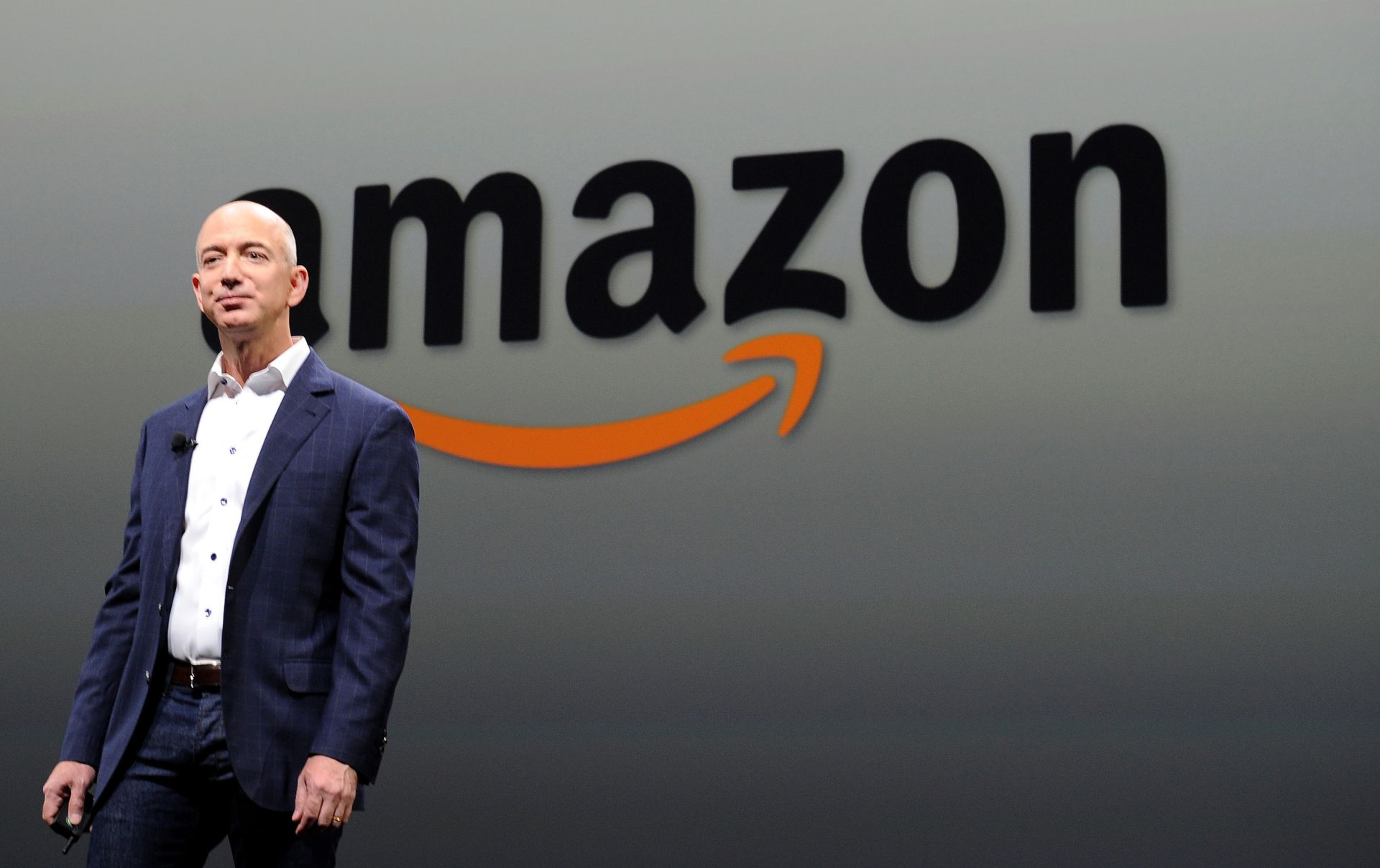 """(FILES) In this September 6, 2012 file photo, Jeff Bezos, CEO of Amazon, speaks during a press conference in Santa Monica, California.  Amazon founder Jeff Bezos acknowledged on December 2, 2014 missteps which have cost the tech giant billions, but said that is the price for taking """"bold bets."""" """"I've made billions of dollars of failures at Amazon.com,"""" Bezos told a New York conference sponsored by the news website Business Insider.  AFP PHOTO /JOE KLAMAR / FILES"""