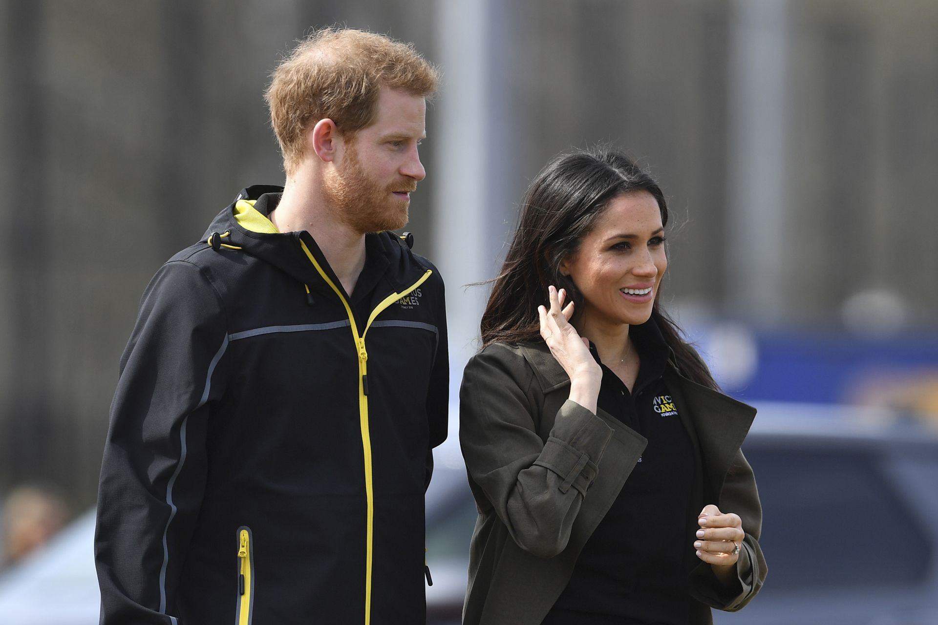 Britain's Prince Harry (L) and his fiancee US actress Meghan Markle (R) arrive to meet participants at the UK team trials for the Invictus Games Sydney 2018 at the University of Bath Sports Training Village in Bath, southwest England on April 6, 2018.The Invictus Games is an international sport event for wounded, injured and sick (WIS) servicemen and women, both serving and veteran. The Games aims to use the power of sport to inspire recovery, support rehabilitation and generate a wider understanding of al