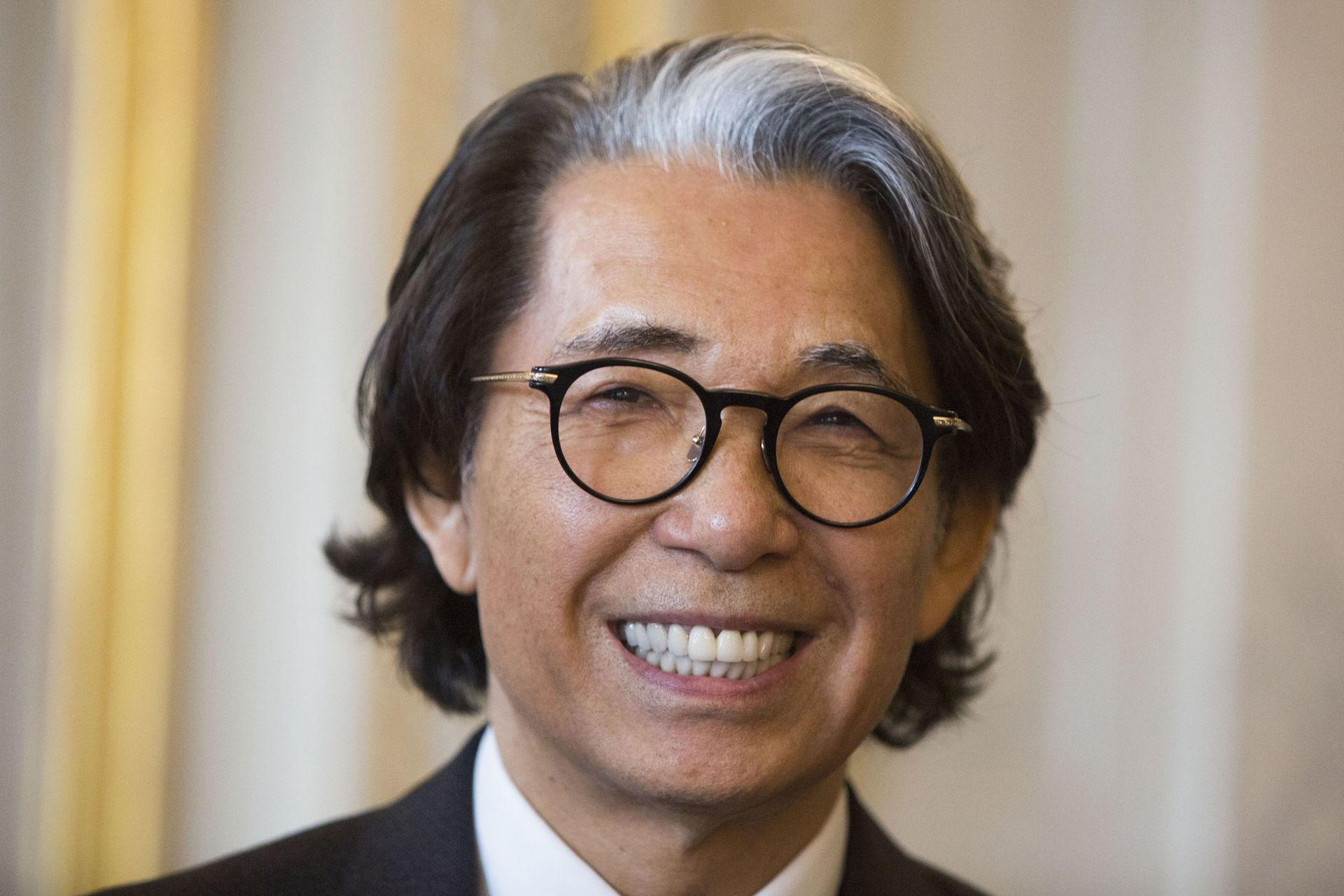 Japanese fashion designer Kenzo Takada smiles after being awarded Chevalier de la LÈgion d'Honneur (Knight of the Legion of Honour) by President of the French Constitutional Council, in Paris, on June 02, 2016.Kenzo Takada, 77, is the founder of the Kenzo brand.  / AFP PHOTO / Geoffroy Van der Hasselt