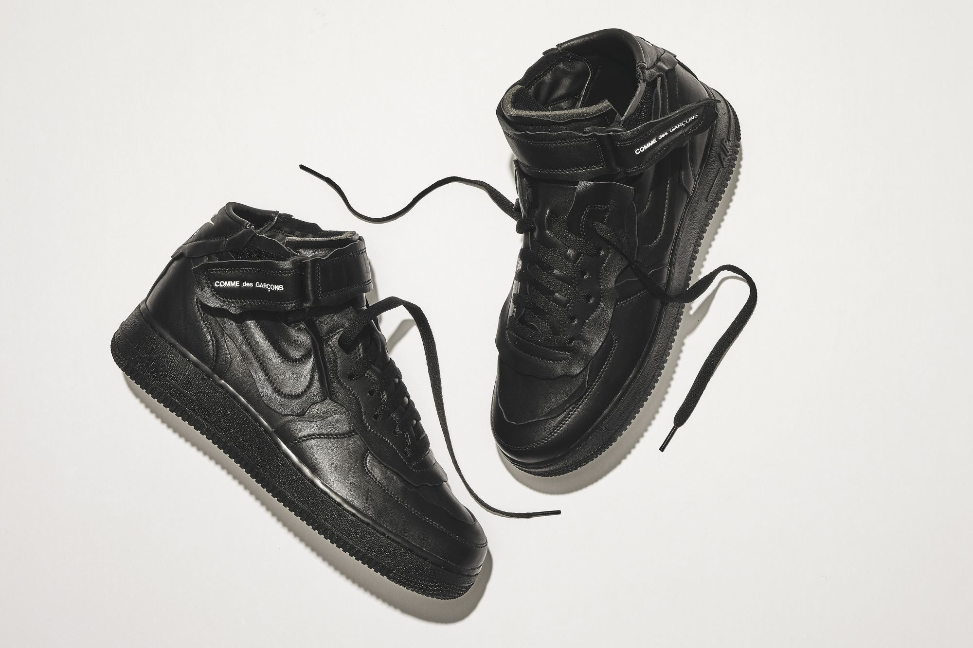 The Nike Comme des Garçons Air Force 1 Mid Drops on October 23 at Dover Street Market