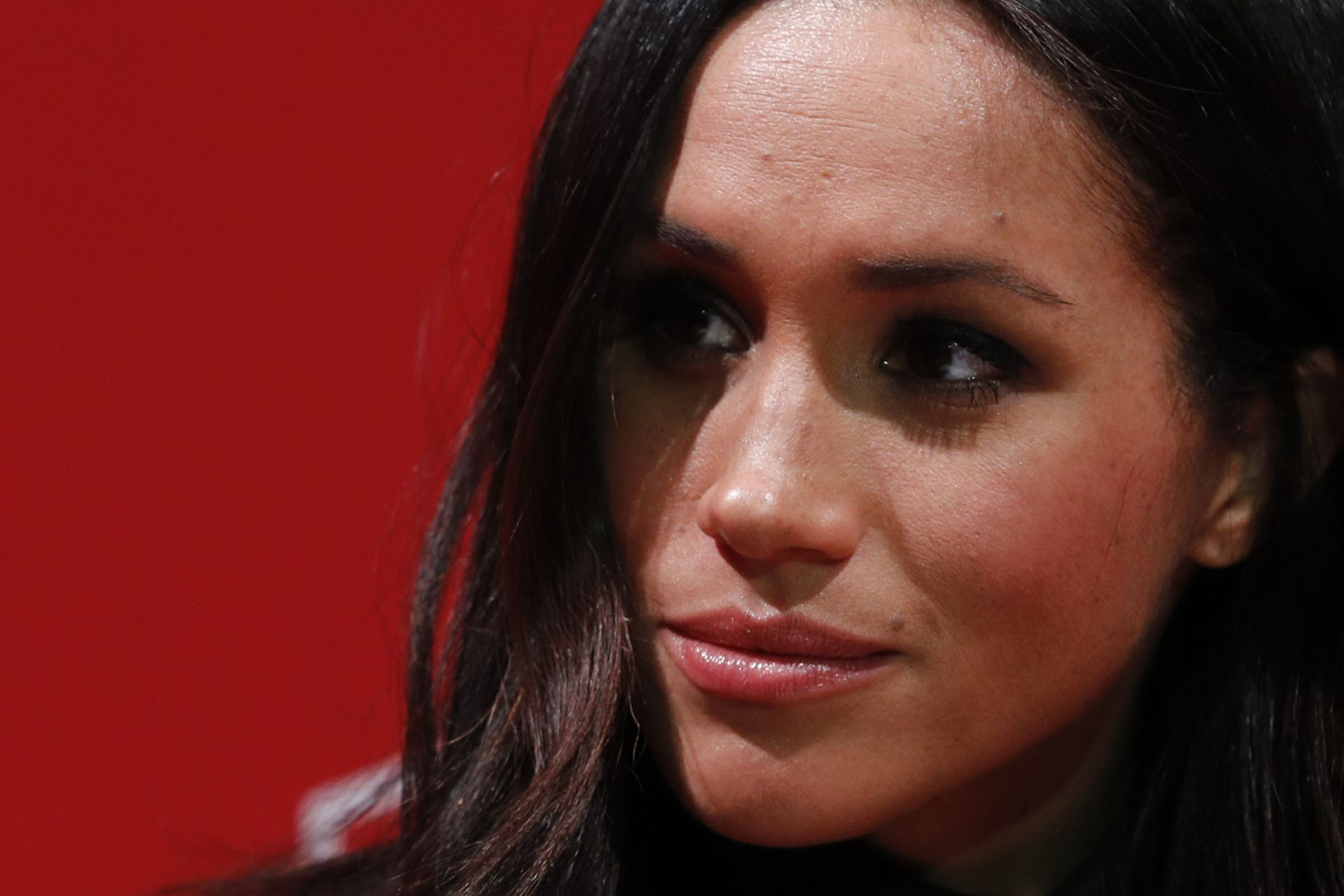 (FILES) In this file photo taken on December 01, 2017 Britain's Prince Harry's fiancee US actress Meghan Markle gestures as they tour the Terrence Higgins Trust World AIDS Day charity fair at Nottingham Contemporary in Nottingham, central England, on December 1, 2017. - Meghan Markle has revealed she suffered a miscarriage in July this year, writing in the New York Times on November 25, 2020 of the deep grief and loss she endured with her husband Prince Harry. (Photo by Adrian DENNIS / various sources / AFP