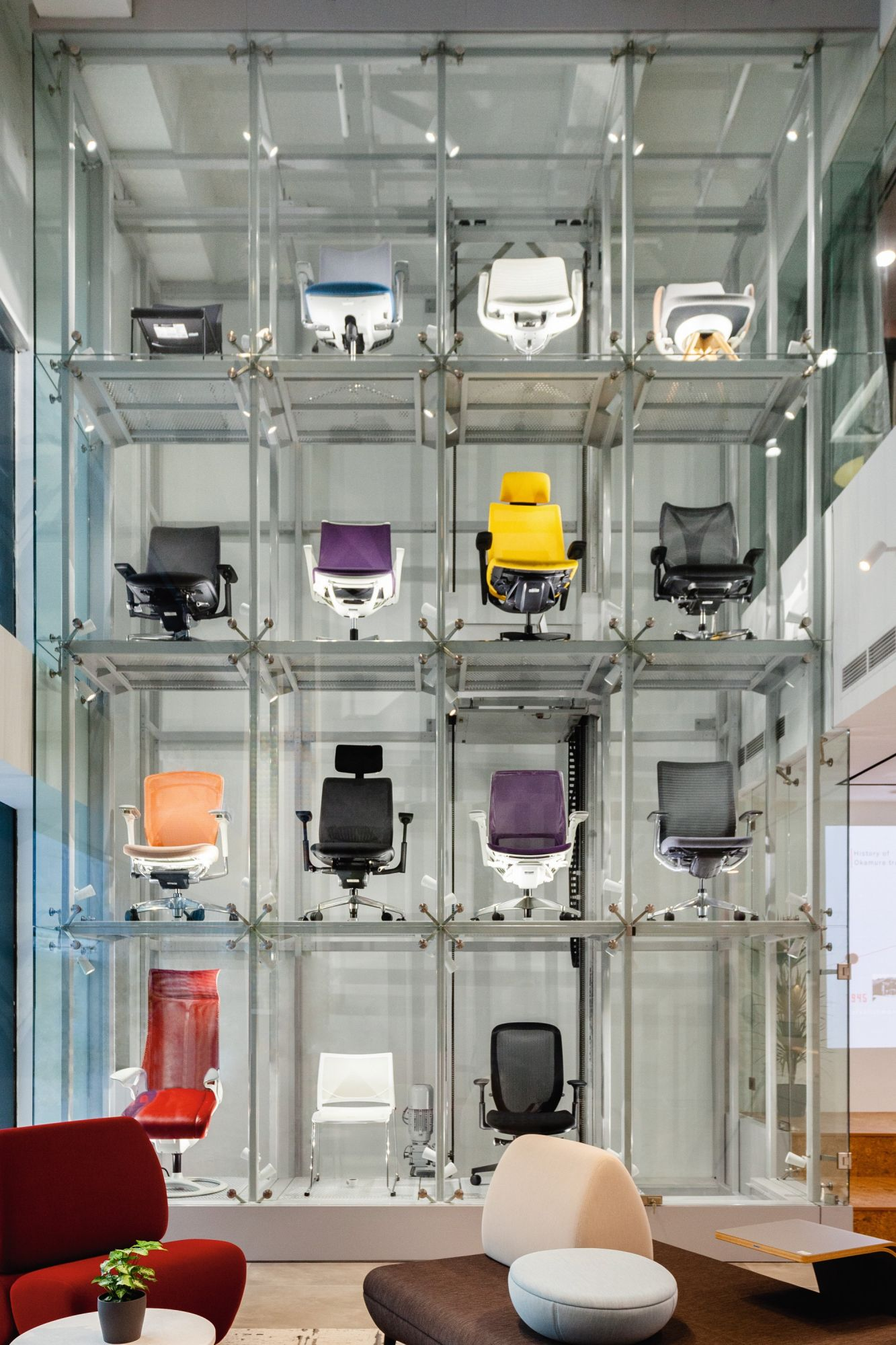 The Okamura Singapore showroom features a chair display inspired by the gachapon vending machines popular in Japan