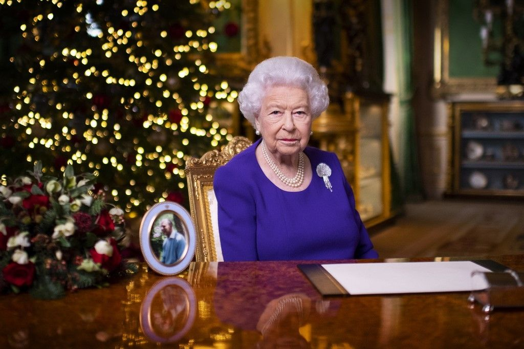 A picture released on December 24, 2020 shows Britain's Queen Elizabeth II posing for a photograph after she recorded her annual Christmas Day message, in Windsor Castle, west of London. (Photo by Victoria Jones / POOL / AFP) / EMBARGOED: not for publication in any territory before 1500 LOCAL TIME.