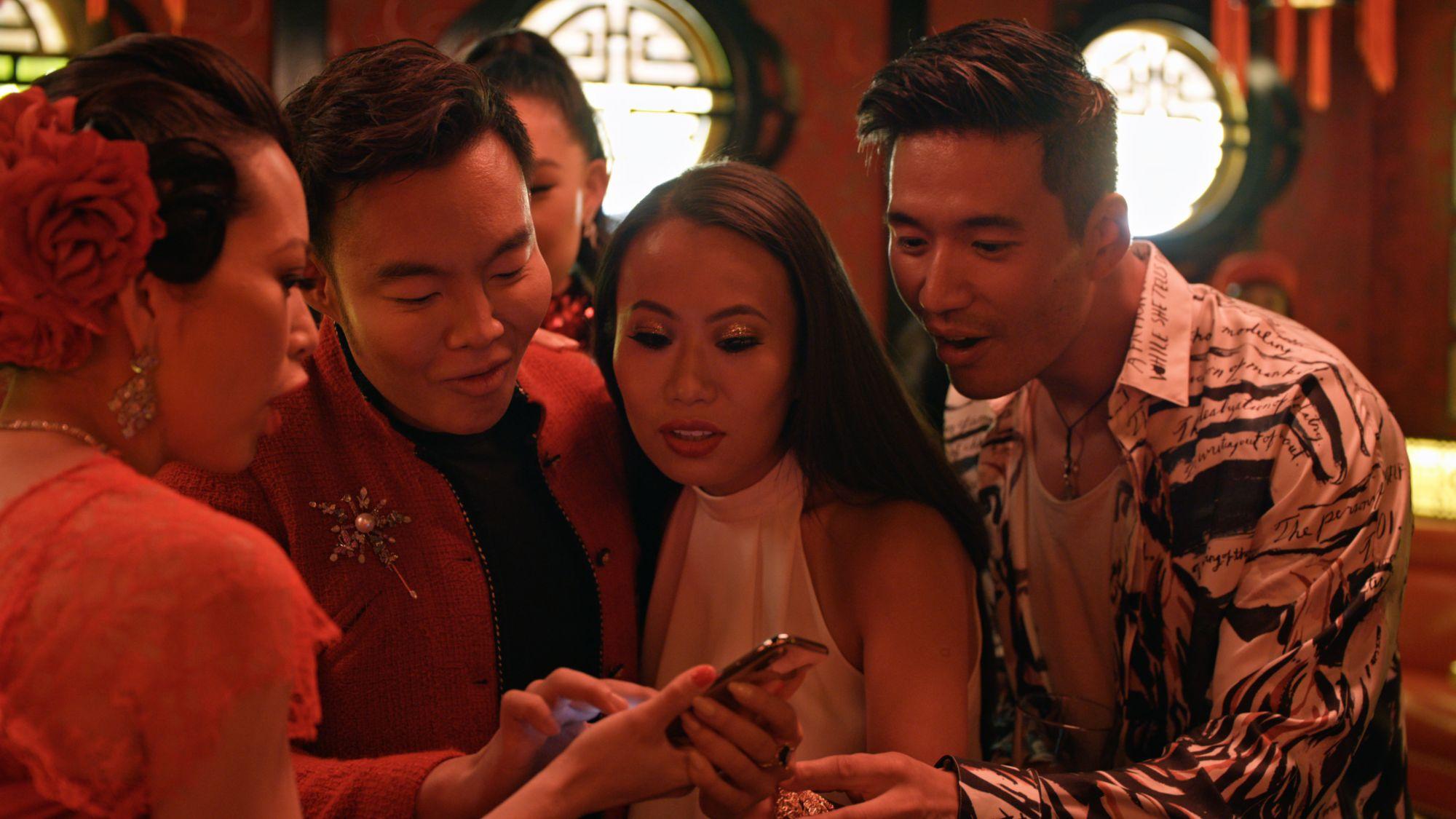 "(L-R) Christine Chiu, Kane Lim, Kelly Mi Li and Kevin Kreider. in episode 3 ""What's in Anna's Shower?"" of Bling Empire: Season 1. c. Courtesy of Netflix © 2021"