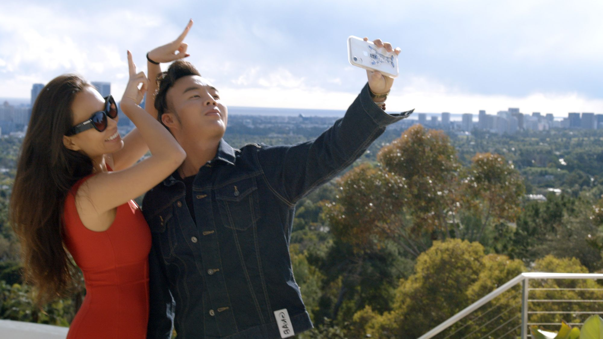 """(L-R) Kelly Mi Li and Kane Lim in episode 1 """"Necklacegate 90210"""" of Bling Empire: Season 1. c. Courtesy of Netflix © 2021"""