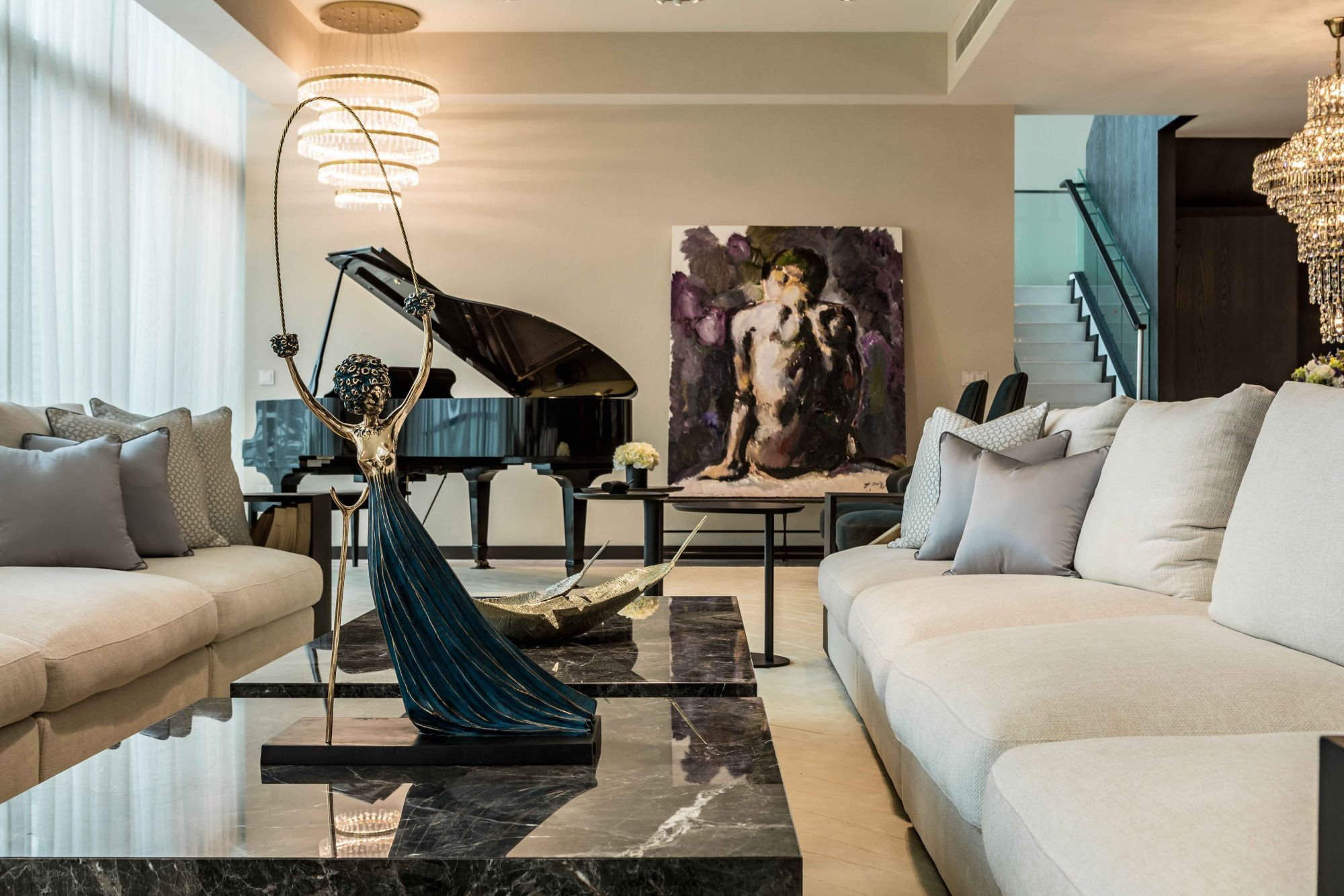 Salvador Dali's Alice In Wonderland sculpture, displayed on a coffee table in a project designed by Edmund Ng Architects