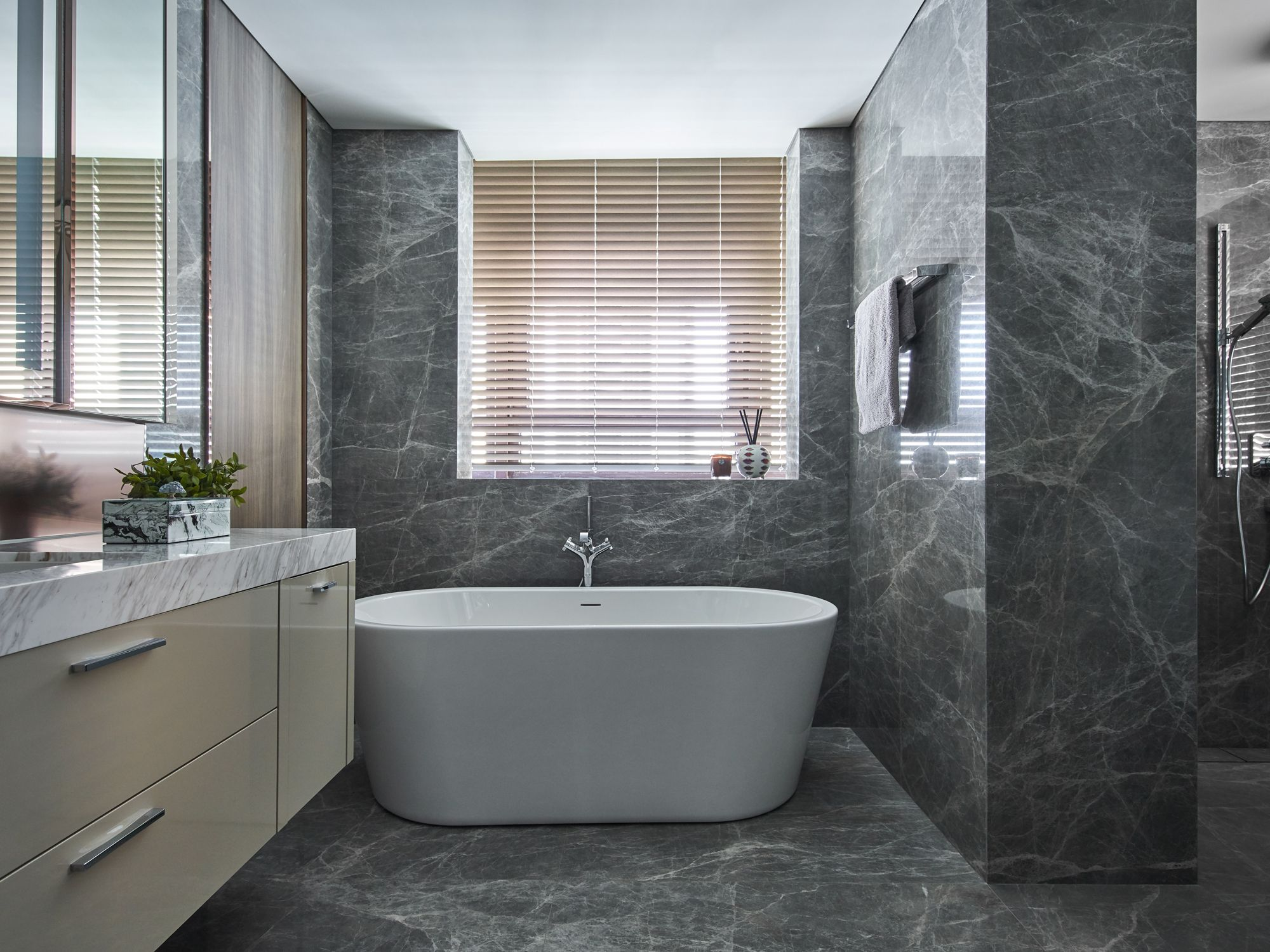 The master bathroom is a tranquil space opulently clad in marble