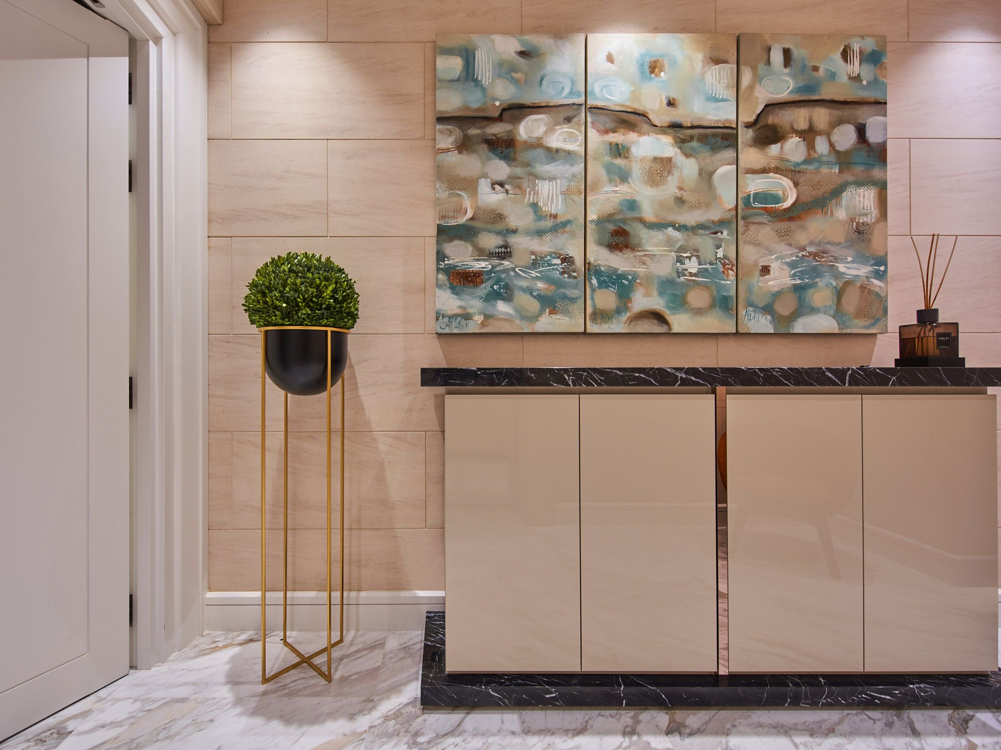 An abstract painting adds artistic flourish to the entryway