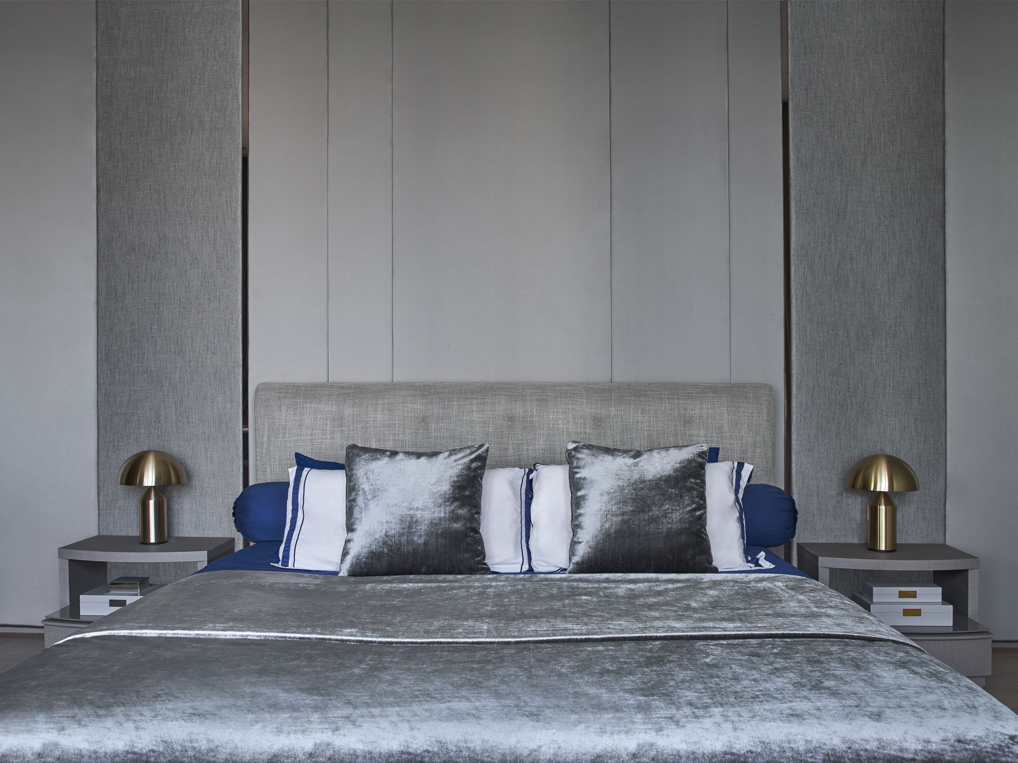 The bedroom features a Minotti bed that takes centre stage