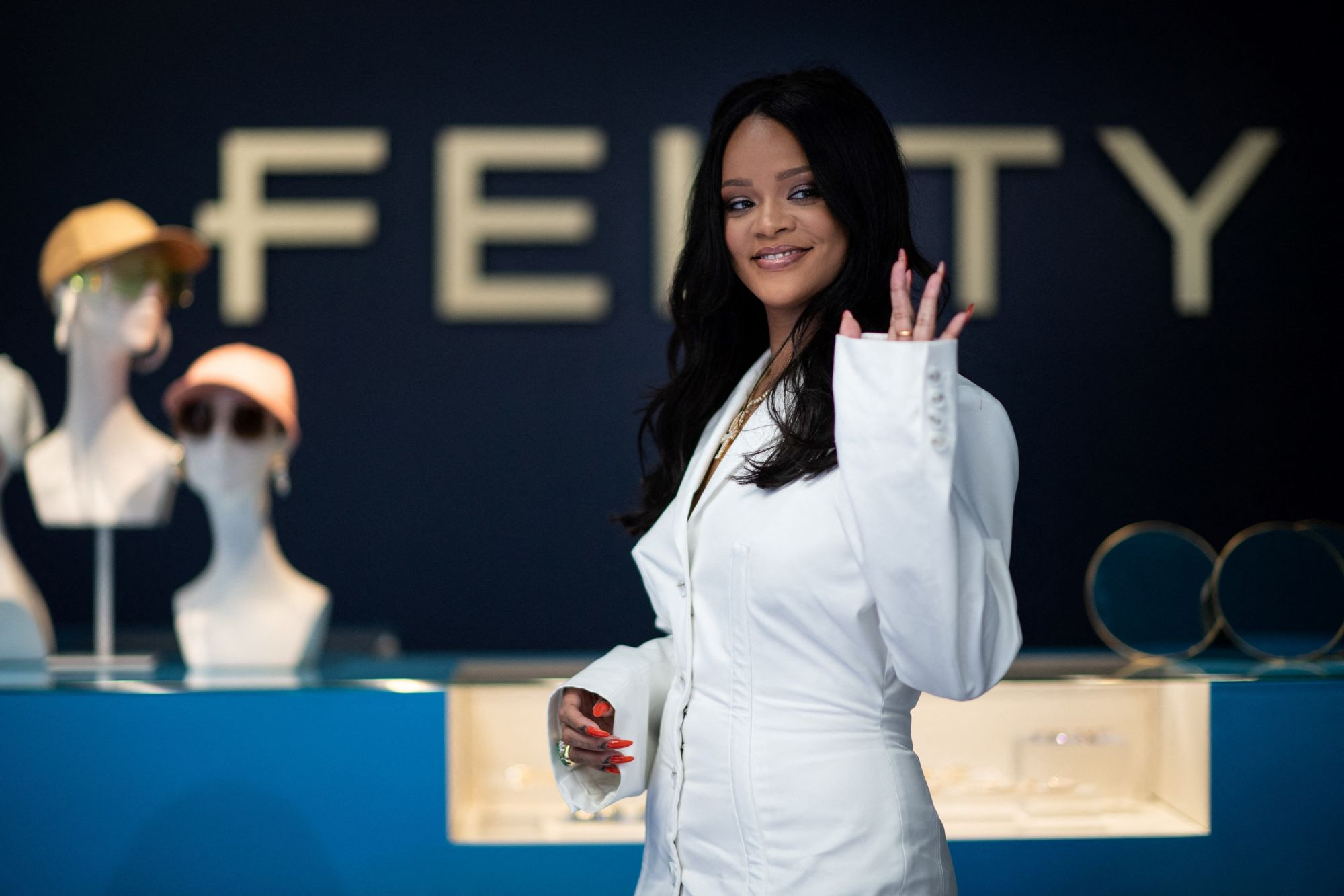 "(FILES) In this file photo taken on May 22, 2019 Barbados' singer Rihanna poses during a promotionnal event of her brand Fenty in Paris on May 22, 2019. - The French luxury giant LVMH announced on February 10, 2021 that it ""suspends the ready-to-wear activity"" that it launched in 2019 with the US pop diva Rihanna, ""based in Europe, pending better conditions"", to focus on ""beauty, care and lingerie"" grouped under the Fenty brand. (Photo by Martin BUREAU / AFP)"