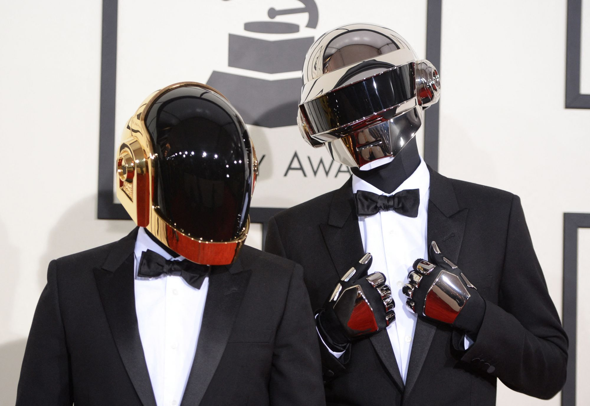 """Nominee For Best Album Of The Year """"Random Access Memories"""" Daft Punk arrive on the red carpet for the 56th Grammy Awards at the Staples Center in Los Angeles, California, January 26, 2014. AFP PHOTO ROBYN BECK (Photo by ROBYN BECK / AFP)"""