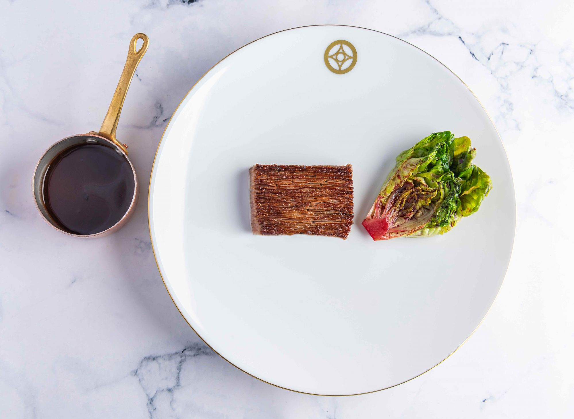 Gunma Wagyu grade 5 served like a millefeuille, capers jus