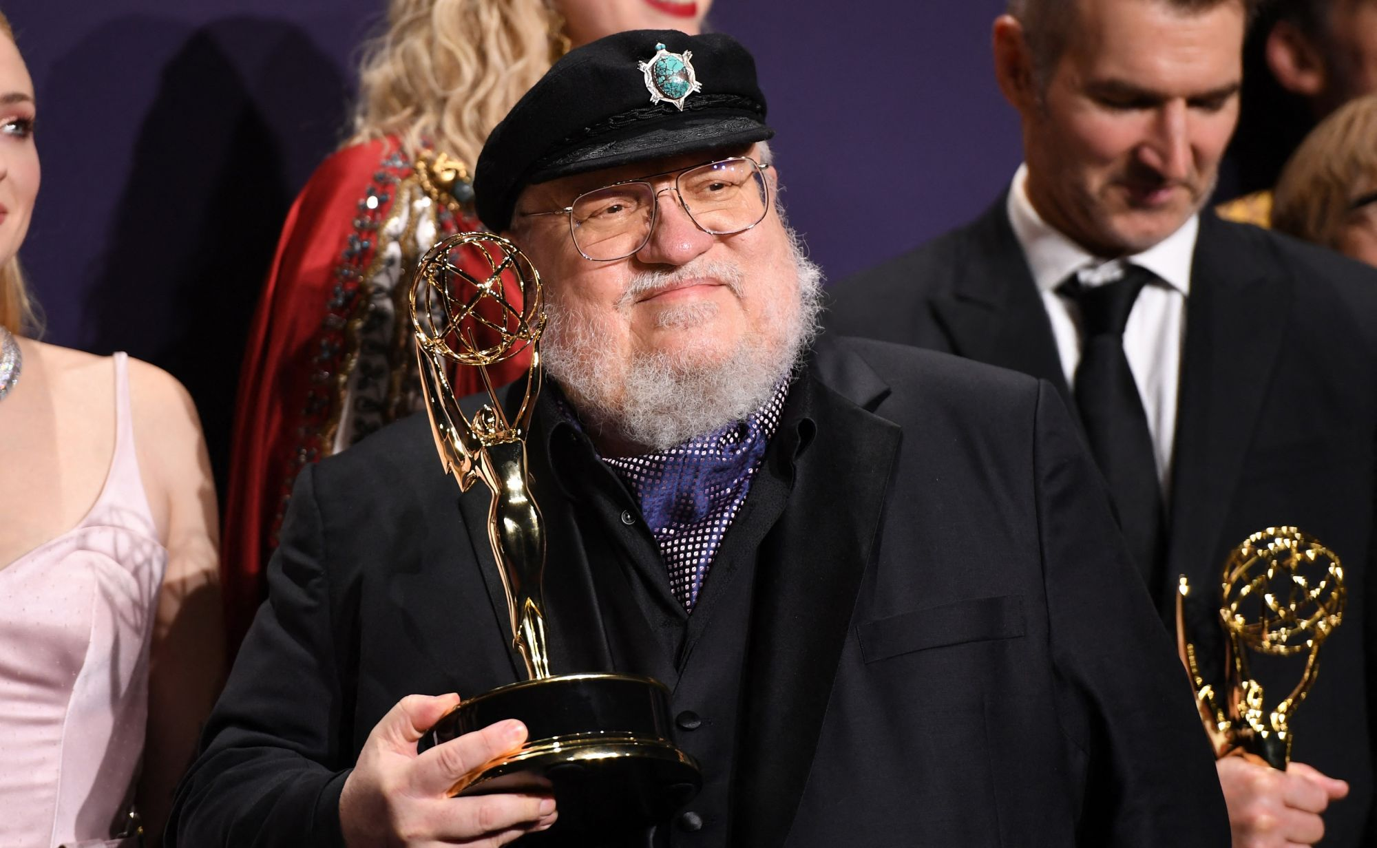 "US novelist George R. R. Martin poses with the Emmy for Outstanding Drama Series ""Game Of Thrones"" during the 71st Emmy Awards at the Microsoft Theatre in Los Angeles on September 22, 2019. (Photo by Robyn Beck / AFP)"