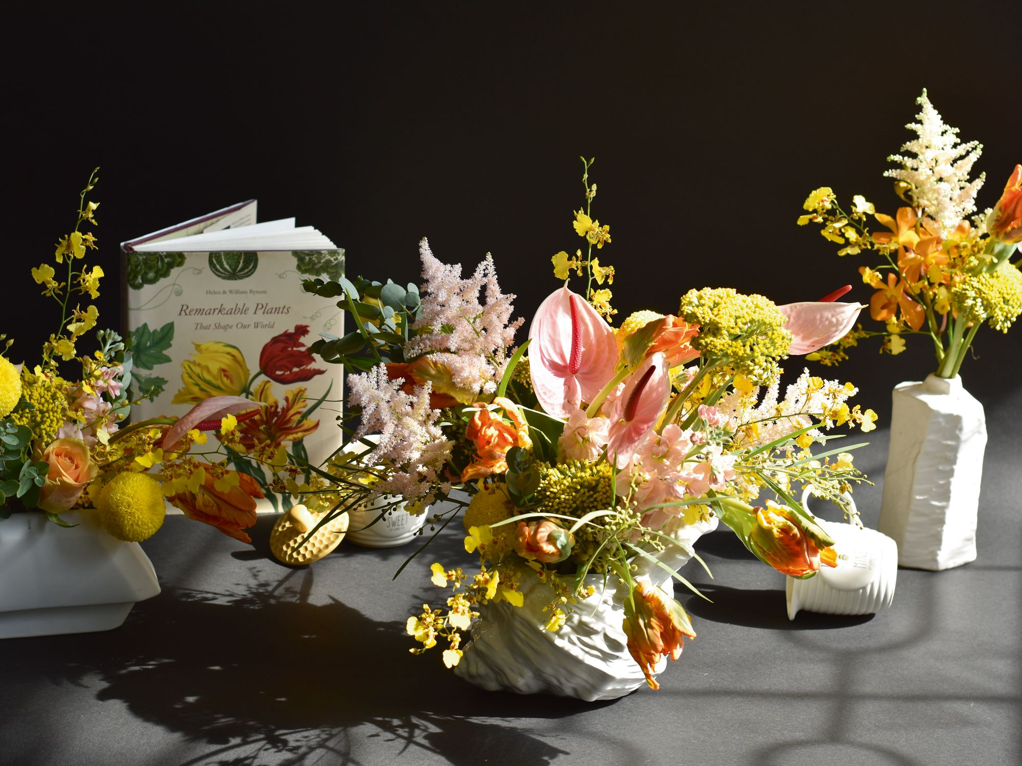 This colourful tablescape by Charlotte Puxley plays with proportions by housing the flowers in vessels of varying heights