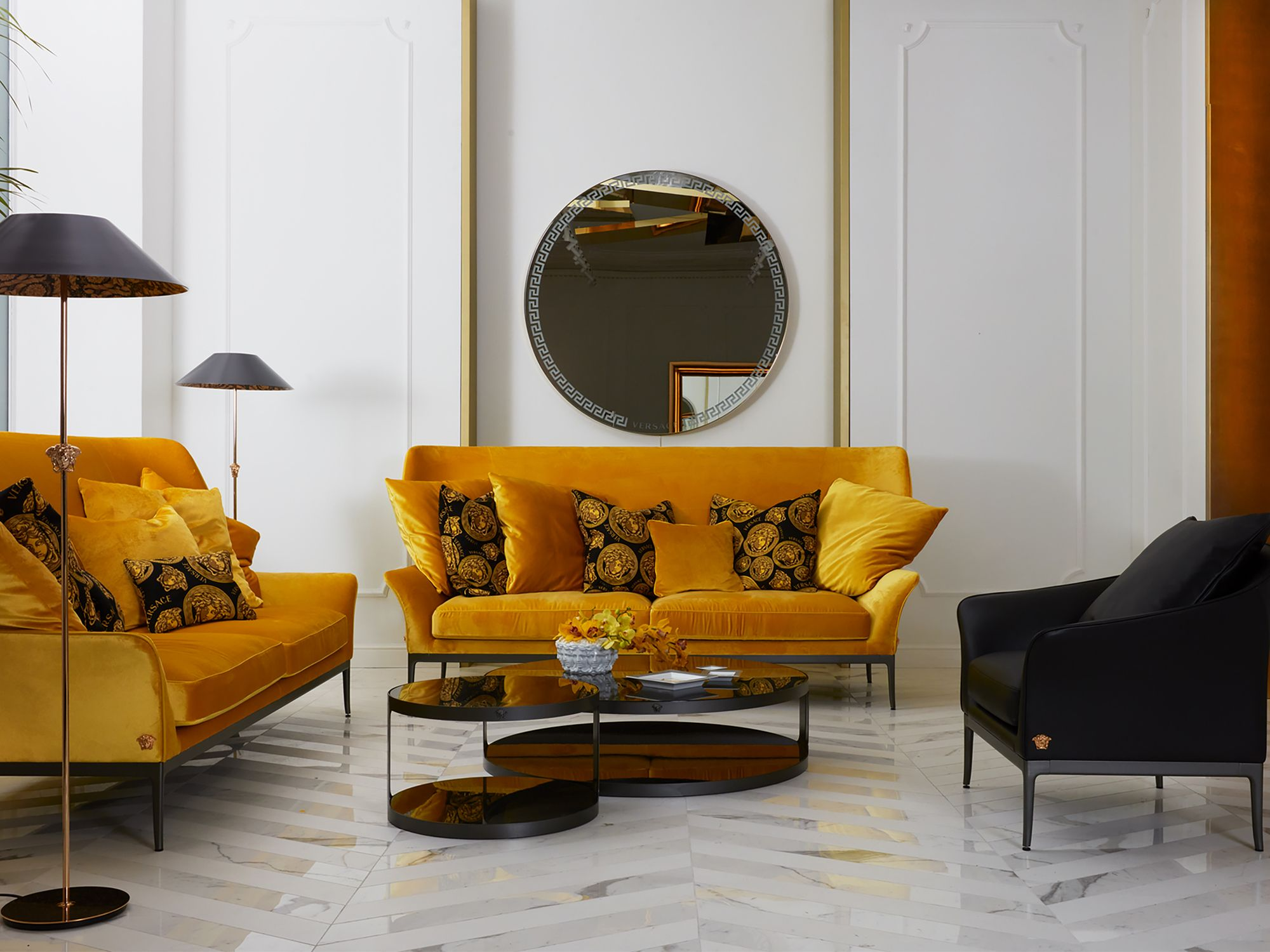 Gold and black influences reign this space in the Versace Home flagship boutique