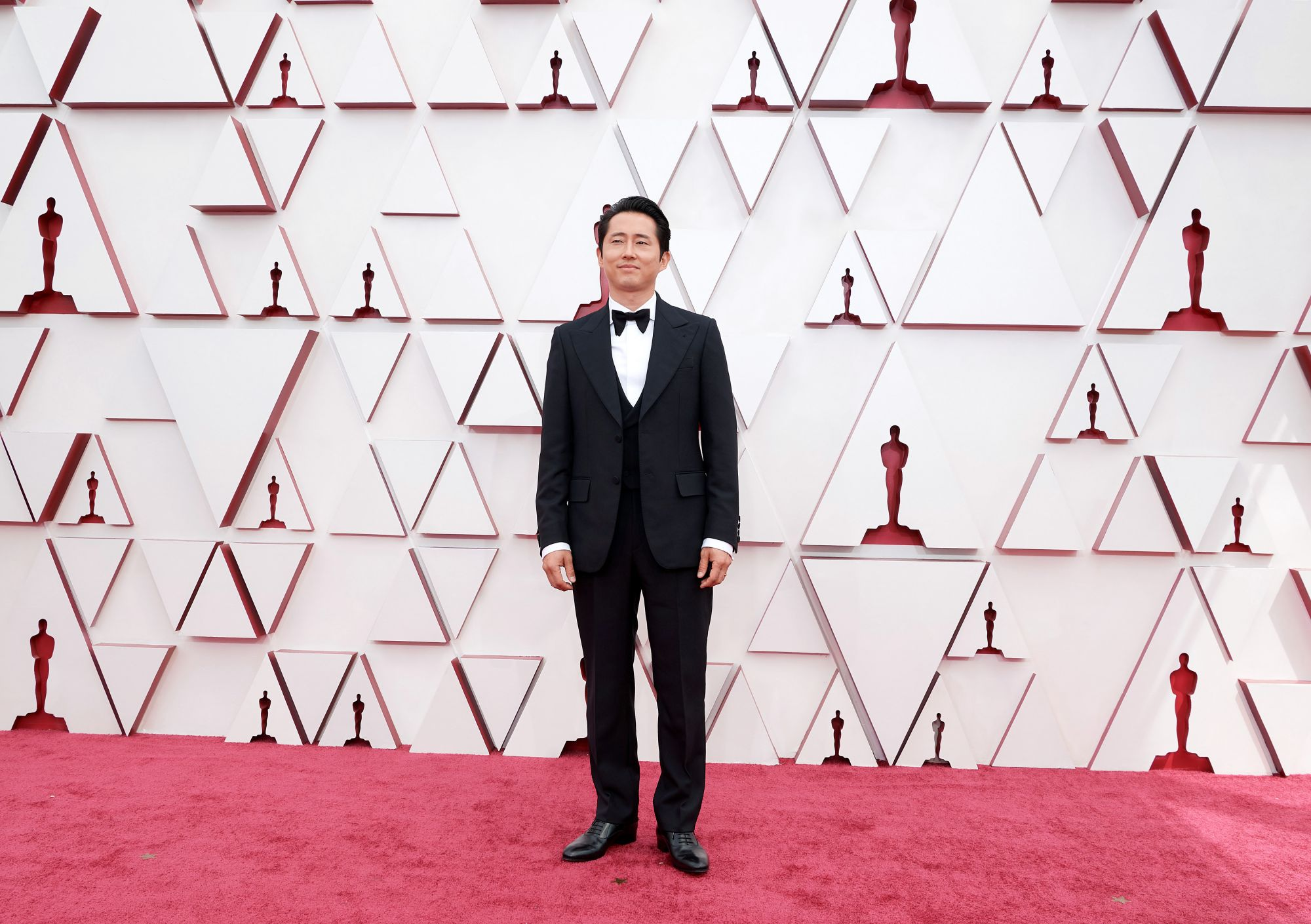 LOS ANGELES, CALIFORNIA – APRIL 25: (EDITORIAL USE ONLY) In this handout photo provided by A.M.P.A.S., Steven Yeun attends the 93rd Annual Academy Awards at Union Station on April 25, 2021 in Los Angeles, California. (Photo by Matt Petit/A.M.P.A.S. via Getty Images)