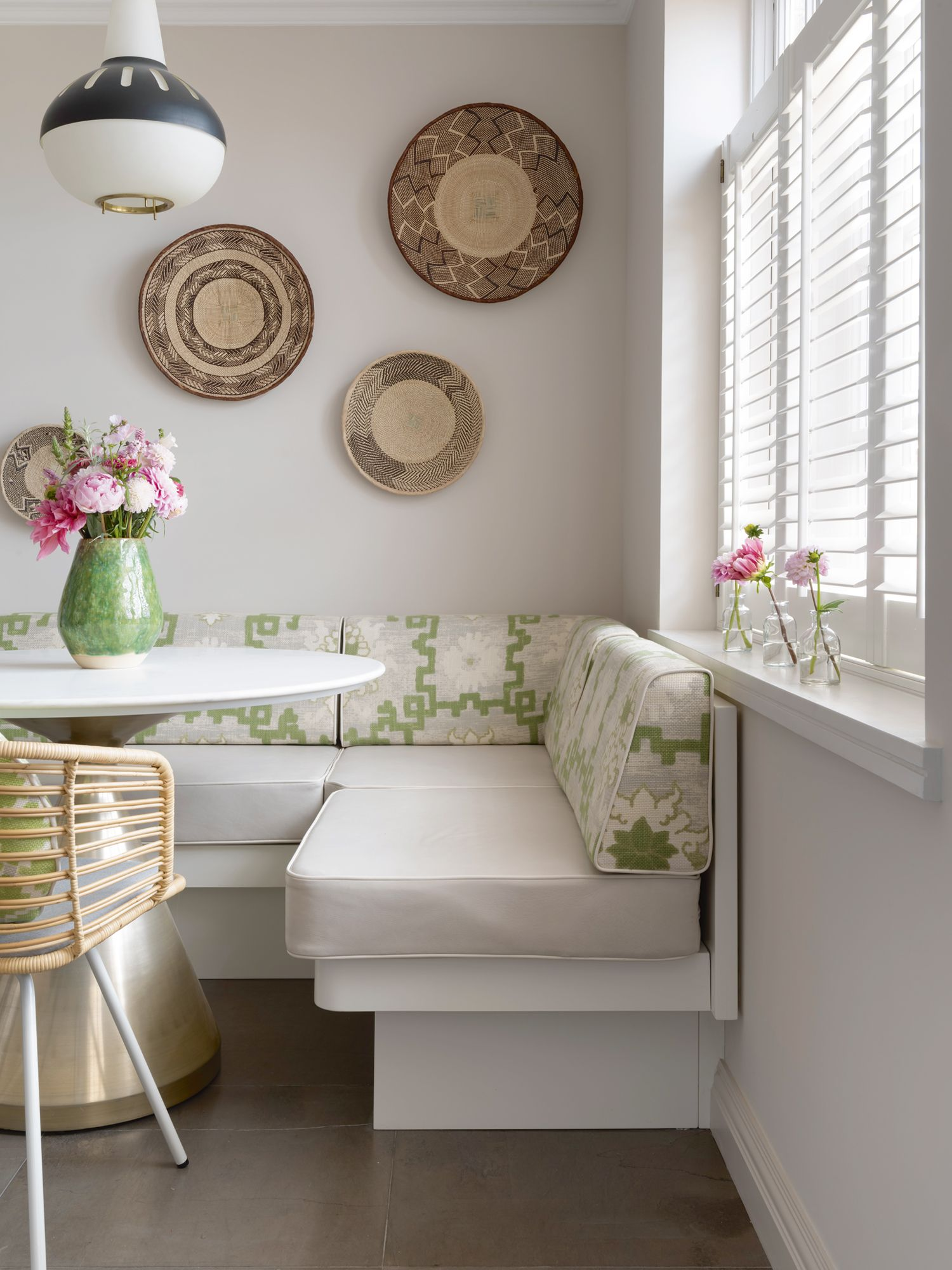 Hints of soft green and pink lend a welcoming air to this cosy nook