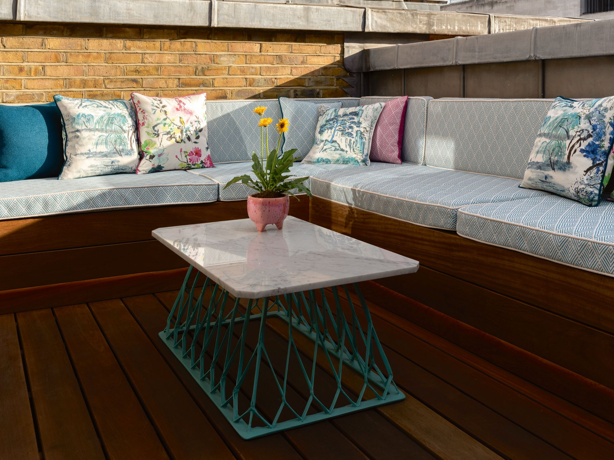 Floral cushions add a colourful touch to this outdoor area