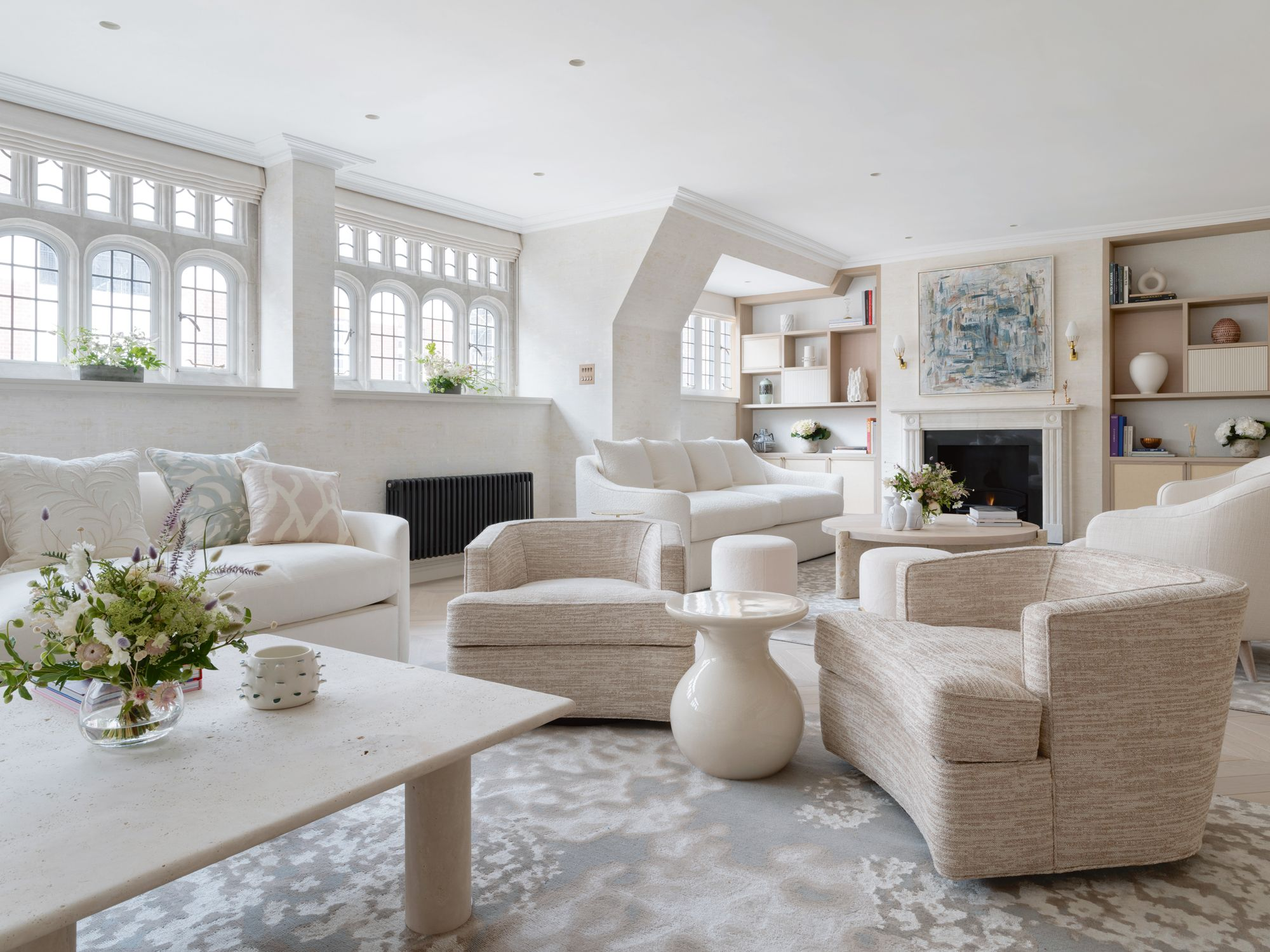 Beige, cream and off-white tones contribute to the lofty look of the living room