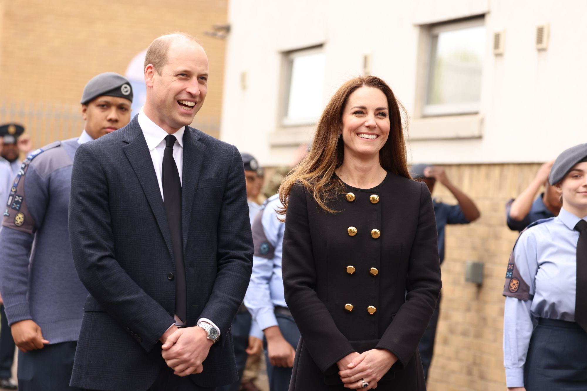 LONDON, ENGLAND – APRIL 21:  Prince William, Duke of Cambridge and Catherine, Duchess of Cambridge, wearing black as a mark of respect following the Duke of Edinburgh's passing, visit 282 East Ham Squadron, Air Training Corps in East London on April 21, 2021 in London, England. During the visit, the Squadron paid tribute to The Duke of Edinburgh, who served as Air Commodore-in-Chief of the Air Training Corps for 63 years. In 2015, The Duke passed the military patronage to The Duchess of Cambridge who be