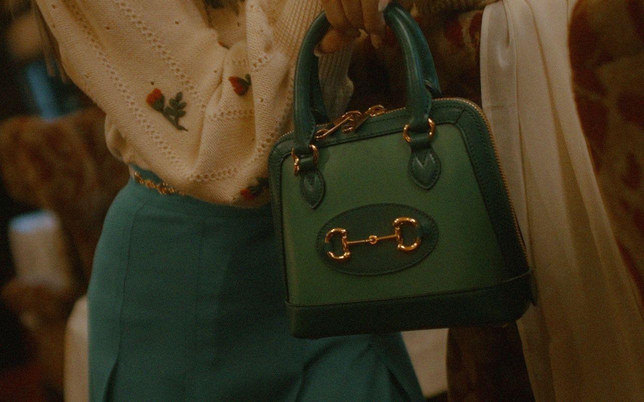 The Gucci Horsebit 1955 mini top-handle in brilliant green with a dark green trim
