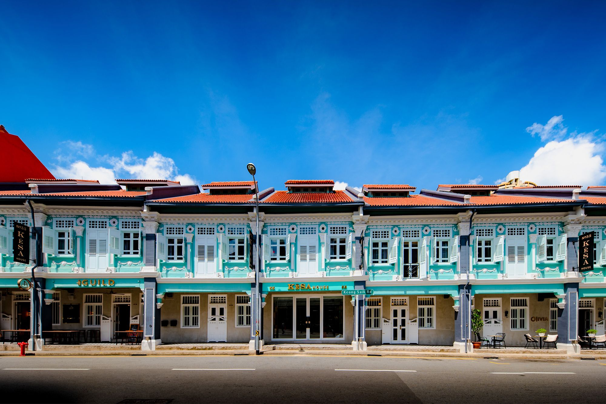 The distinctive blue exterior facade of KeSa House stands out amongst the row of shophouses