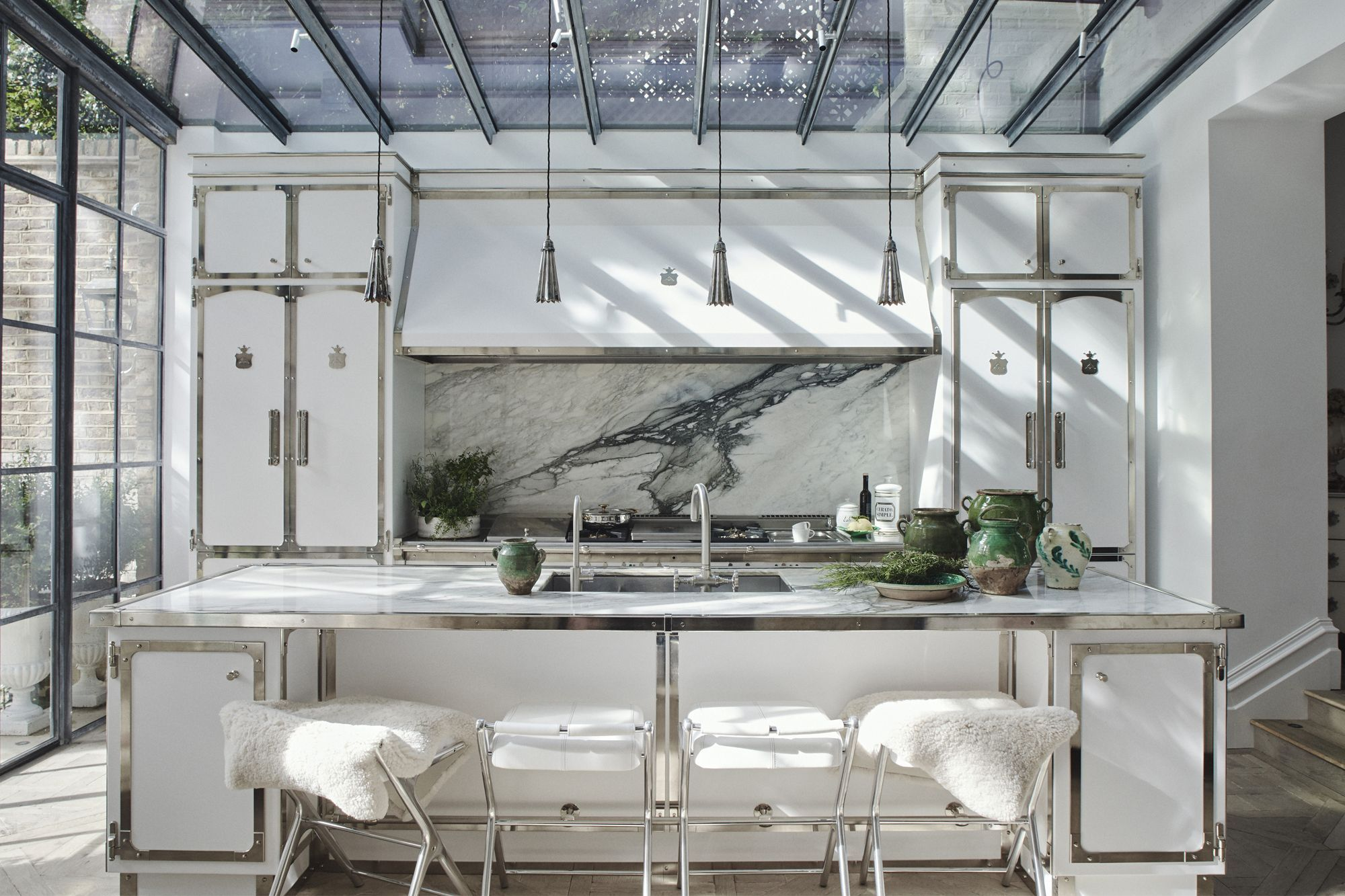 This chic white kitchen, a collaboration between Henry and Italian kitchen manufacturer Officine Gullo, features a mix of finishes that create interesting depth