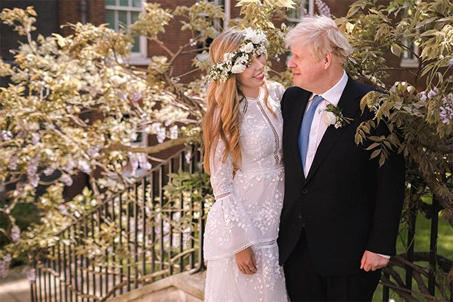 Prime Minister Boris Johnson poses with his wife Carrie Johnson in the garden of 10 Downing Street following their wedding. Photo: Rebecca Fulton / Downing Street via Getty Images