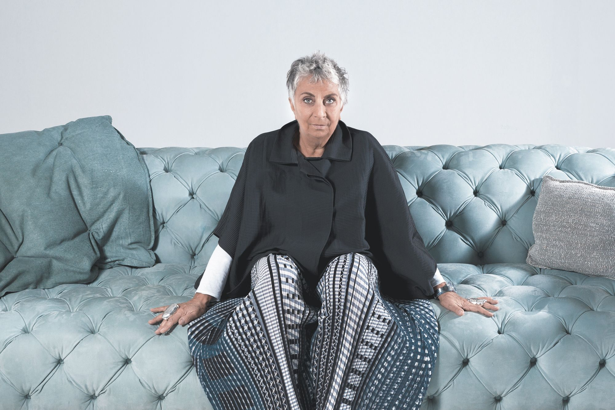 Paola Navone, pictured on the Baxter Chester Moon sofa