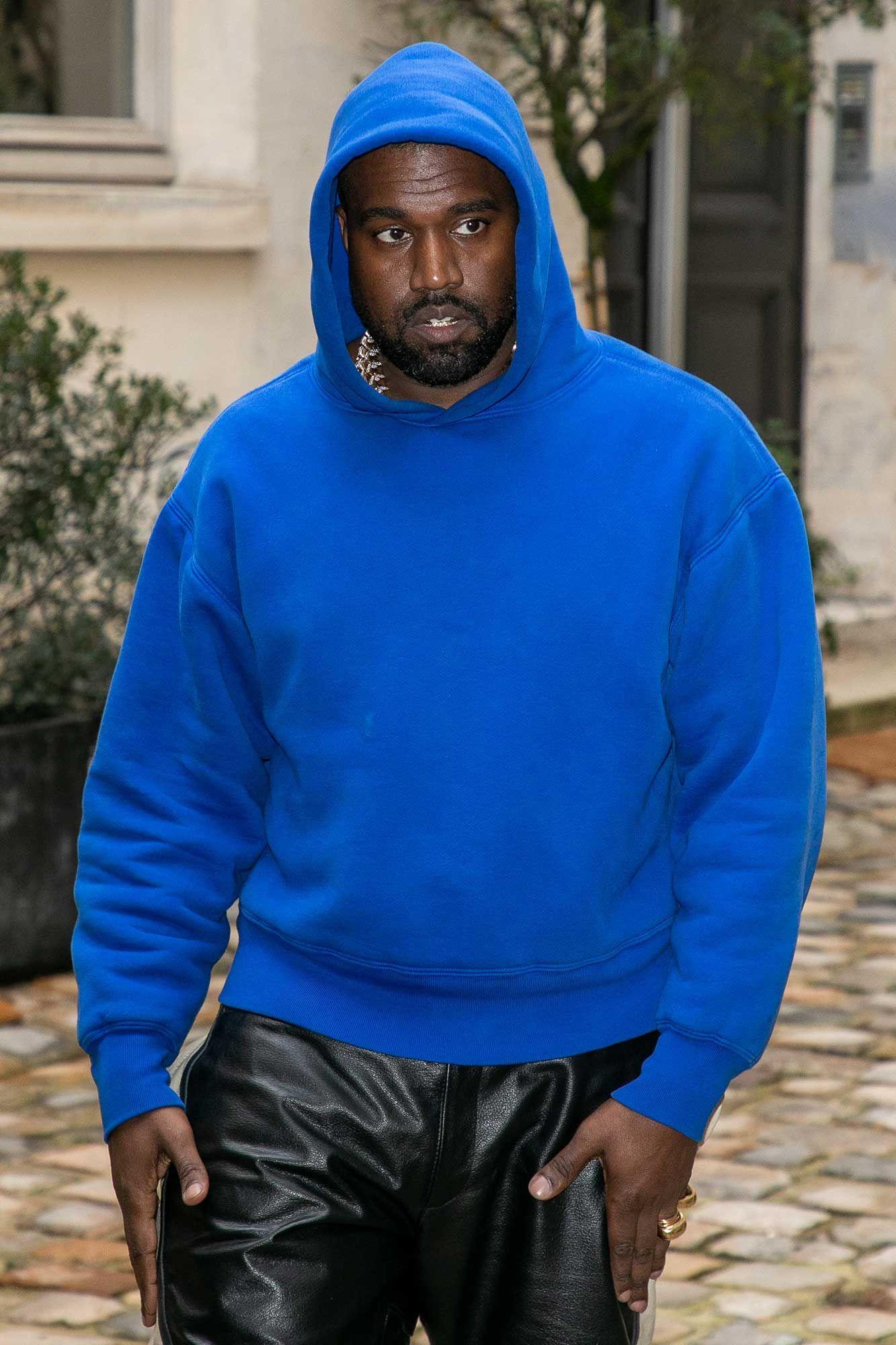 Kanye West wearing a blue hoody