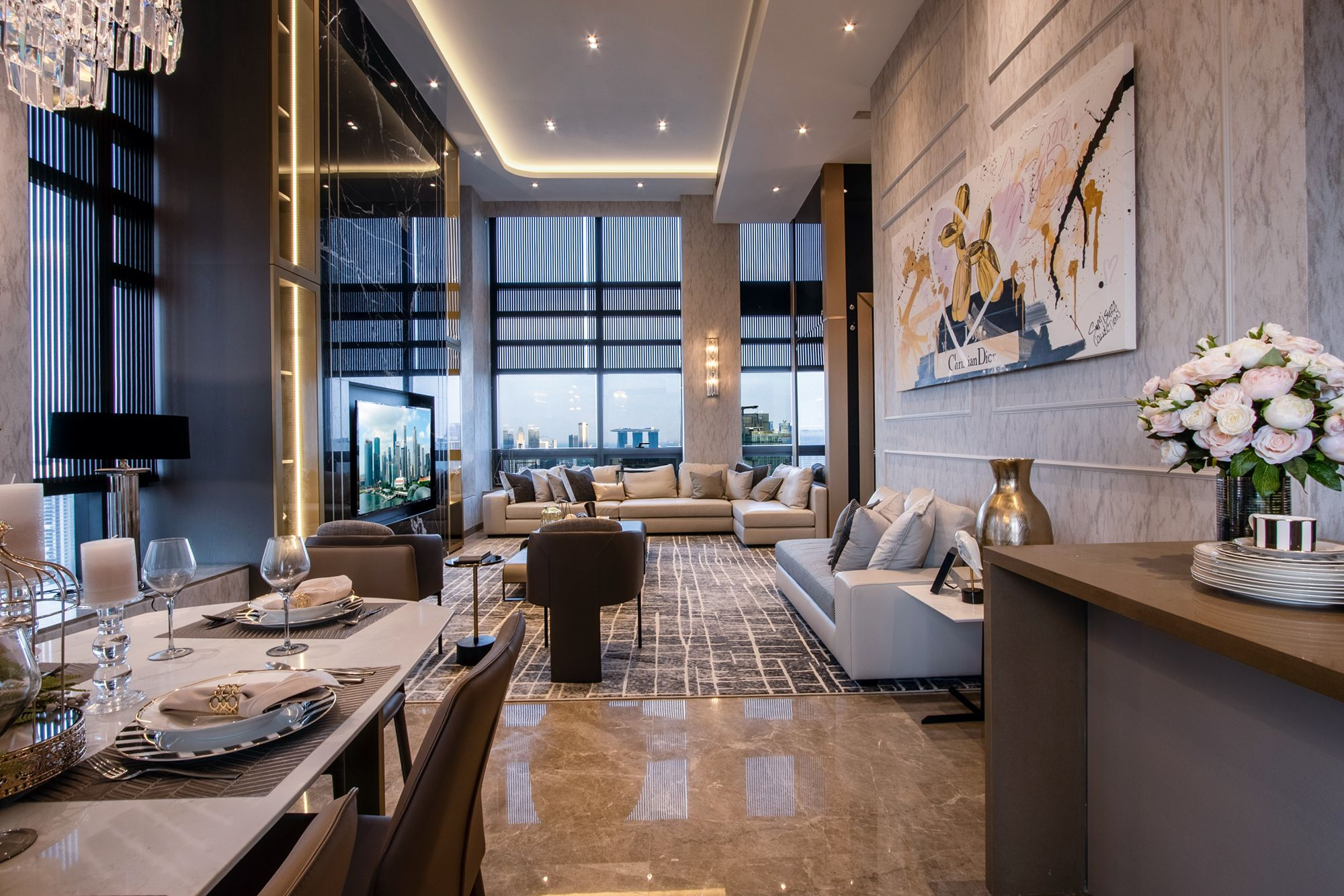 A polished Noir Marquina marble feature wall near the windows is a focal point in the living area