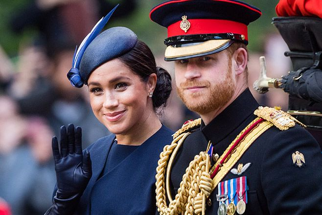 Prince Harry and Meghan ride by carriage down the Mall during Trooping The Colour parade. Photo: Samir Hussein/Samir Hussein/WireImage