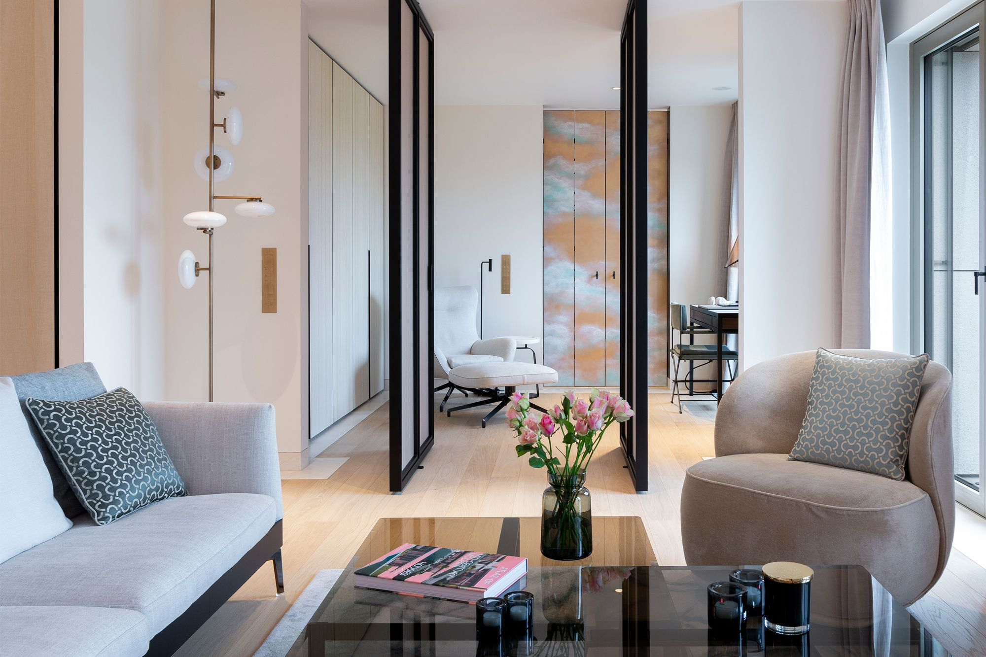 The living room is ingeniously connected to the study via a set of custom-designed pivot doors