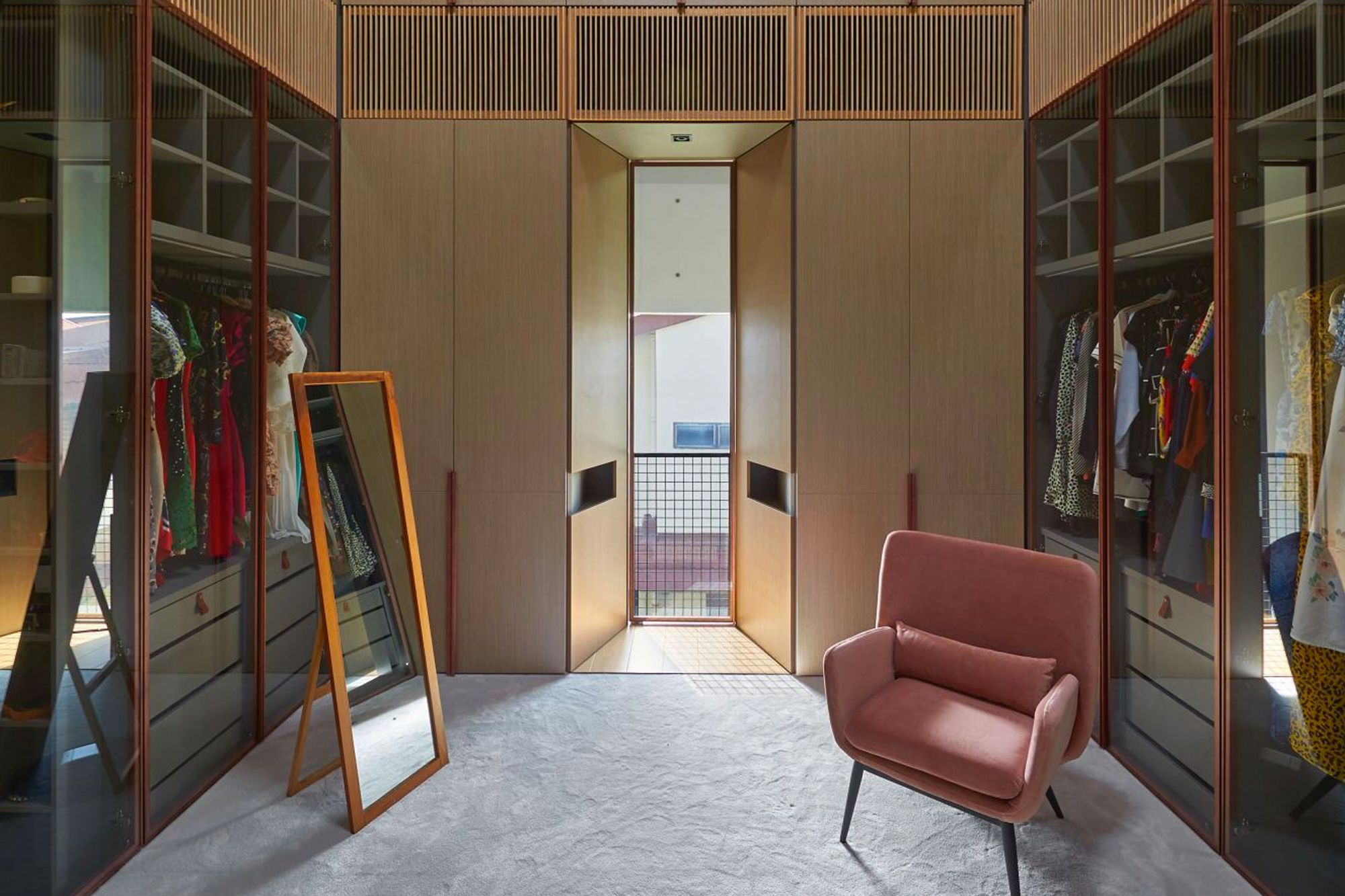 Designed by Rene Tan, co-founder of RT+Q Architects, this walk-in wardrobe features lofty ceilings that create a bright and airy atmosphere