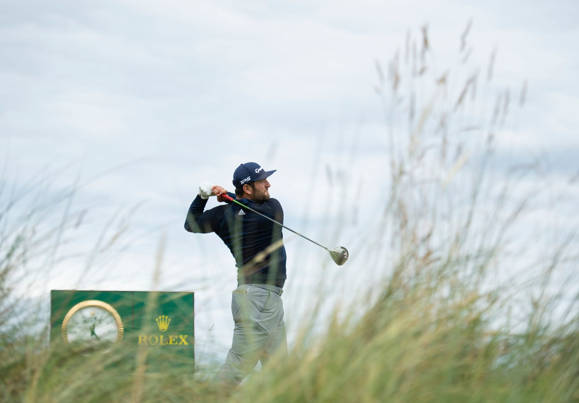 Rolex Testimonee Jon Rahm teeing off on the eighth hole at The 14th Open (Photos: Rolex)